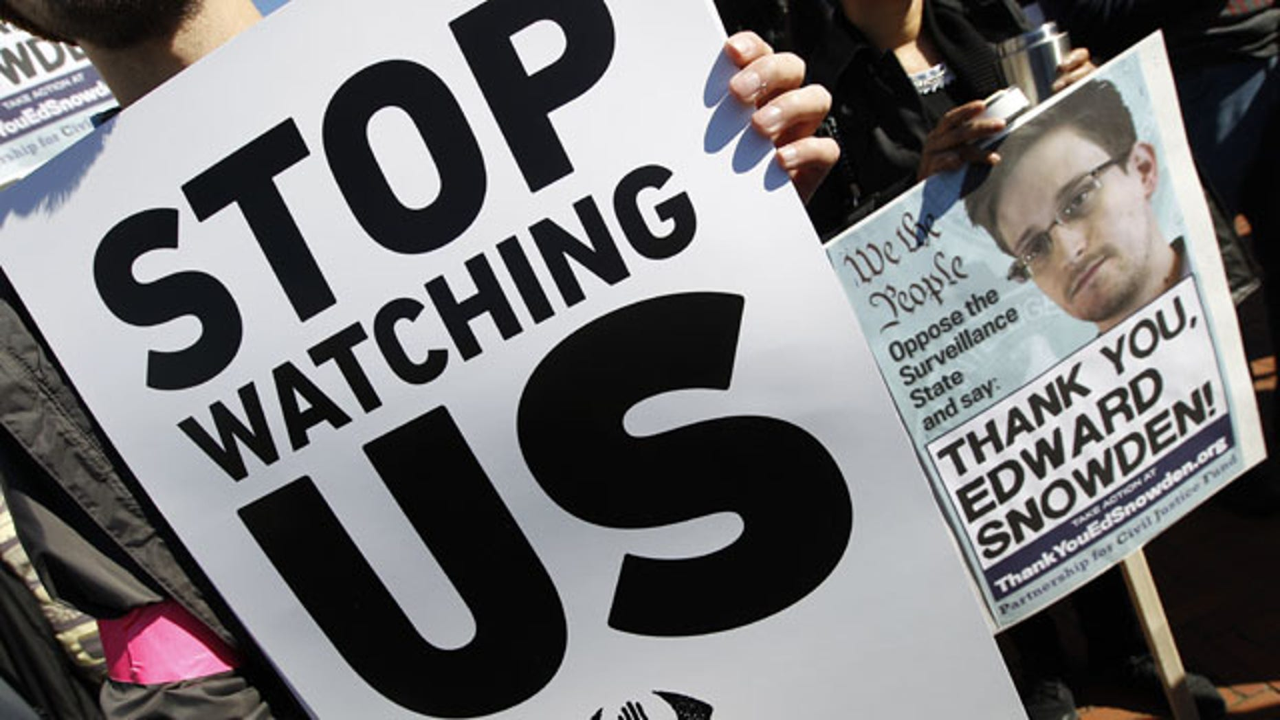 October 26, 2013: Demonstrators protest outside of the U.S. Capitol in Washington during a rally to demand that the U.S. Congress investigate the National Security Agency's mass surveillance programs. (AP Photo/Jose Luis Magana)