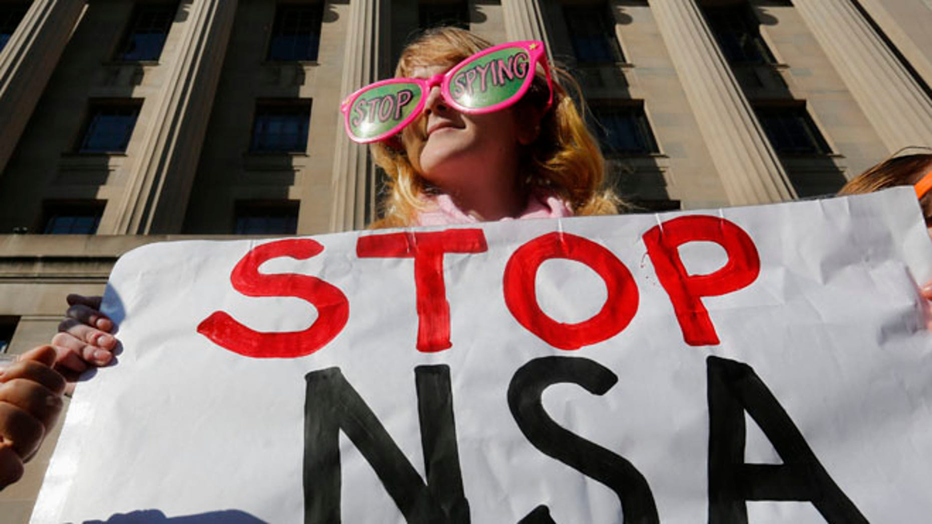 Jan. 17, 2014: Member of the protest group, Code Pink, protests against President Obama and the NSA.