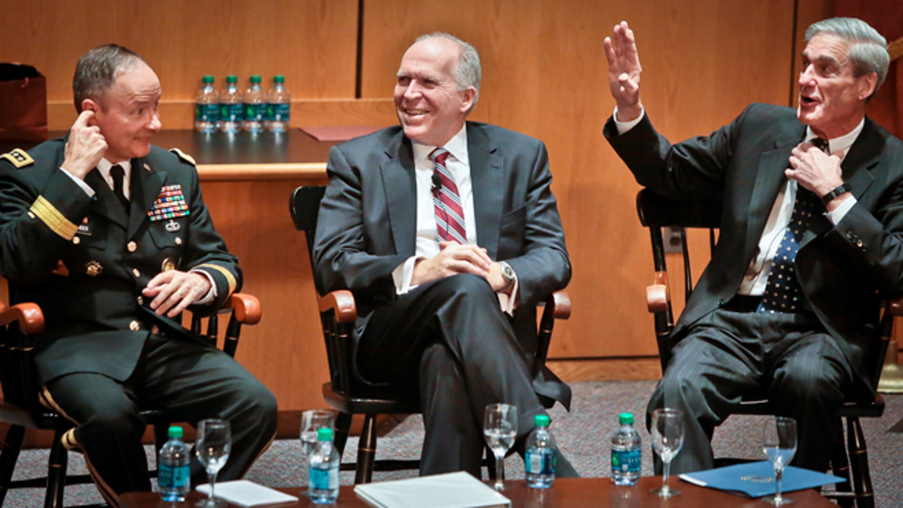 Aug 8, 2013: Director of the National Security Agency (NSA) Gen. Keith B. Alexander, left, director of the Central Intelligence Agency (CIA) John O. Brennan, center, and director of the Federal Bureau of Investigation (FBI) Robert S. Mueller, right, attend a forum during the International Conference on Cyber Security (ICCS) on at Fordham University in New York.