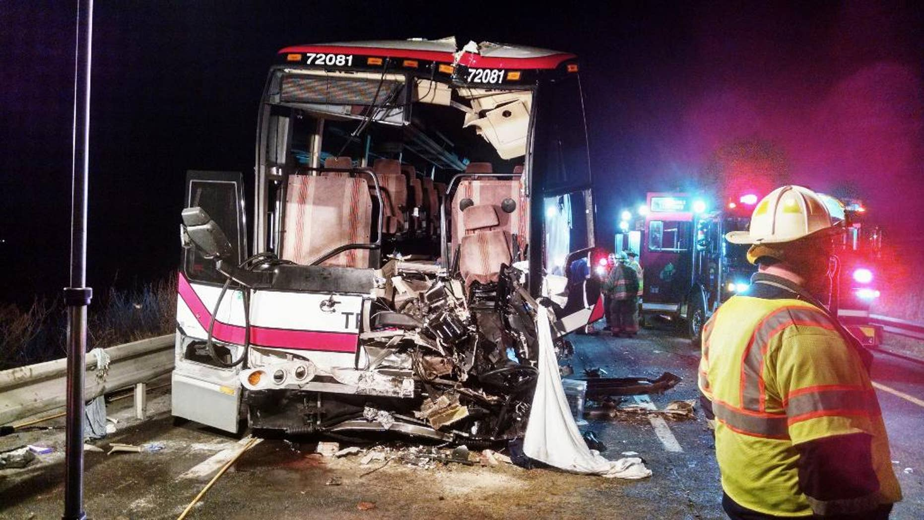 This photo provided by the Onondaga County Sheriff's Office shows the bus involved in a crash with a tractor-trailer and a car that left 27 people injured  on Interstate 81 early Thursday, Nov. 6, 2014, in Nedrow, N.Y. Twenty-six passengers suffered minor injuries on the Pine Hills Trailways bus traveling from Toronto to New York City. The bus driver is in serious condition at a Syracuse hospital. Police say the car driver has been charged with driving while intoxicated.   (AP Photo/Onondaga County Sheriff's Office)