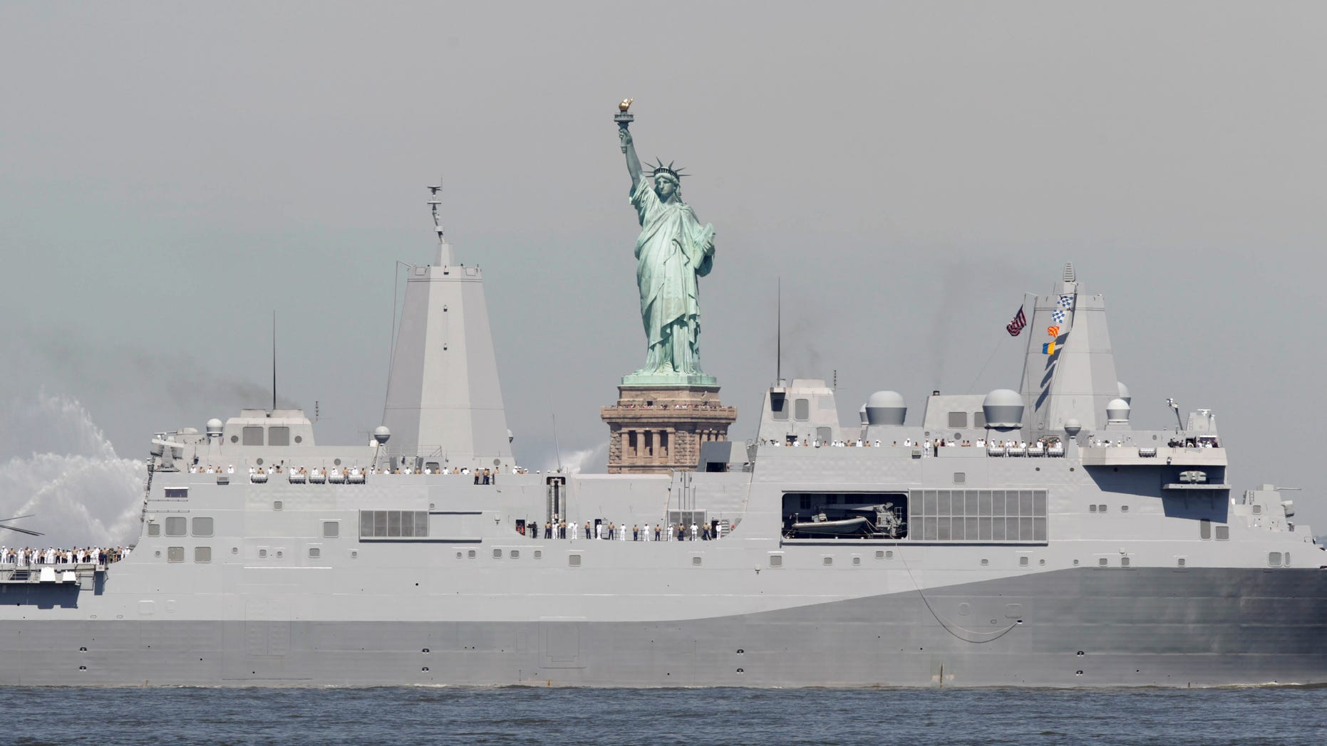 Sailors stand on the deck as the USS New York passes the Statue of Liberty to kick off Fleet Week in New York, Wednesday, May 25, 2011. Fleet Week ends on Memorial Day with a military flyover honoring American military personnel who lost their lives in service.