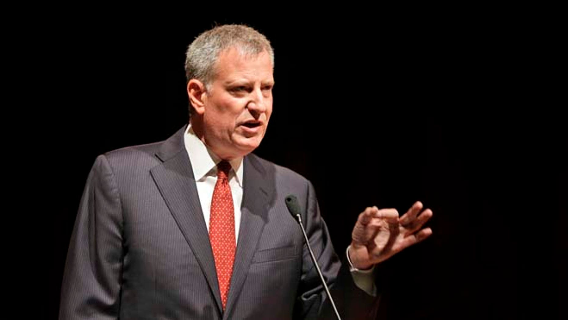 New York City Mayor Bill de Blasio speaks to the graduates of the Boys and Girls High School in the Bedford-Stuyvesant section of Brooklyn in New York, Thursday, June 25, 2015. The New York state legislative session lurched to an end Tuesday, shunting sweeping changes to the side while largely preserving the status quo, an outcome that yielded scant victories and much frustration for de Blasio. (AP Photo/Seth Wenig)