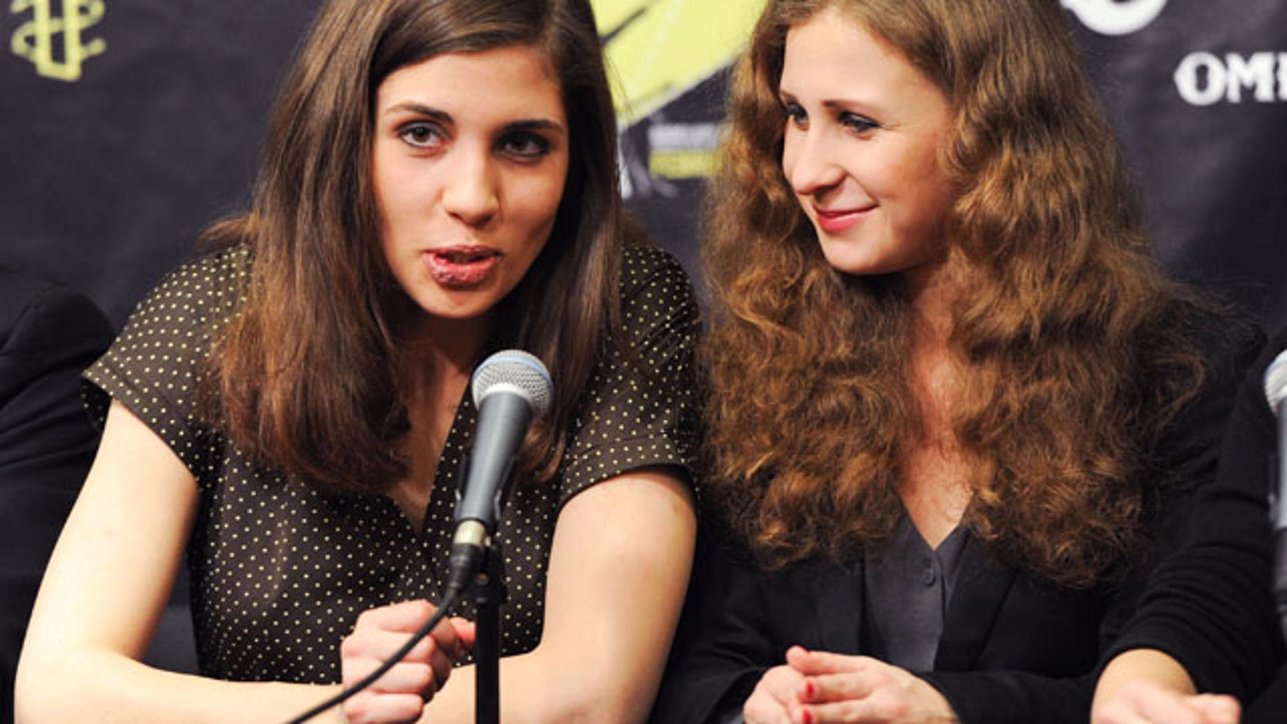 """FILE - In this Feb. 5, 2014 file photo, Nadezhda """"Nadya"""" Tolokonnikova, left, and Maria """"Masha"""" Alekhina of Pussy Riot, participate in a press conference for Amnesty International's """"Bringing Human Rights Home"""" concert at the Barclays Center in New York. (AP)"""