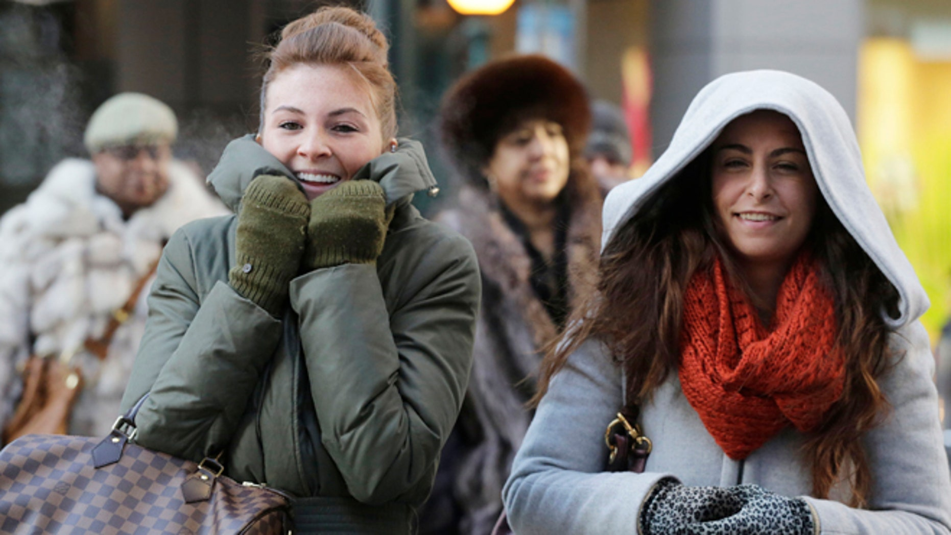 Women are bundled up against the cold on New York's 34th Street.
