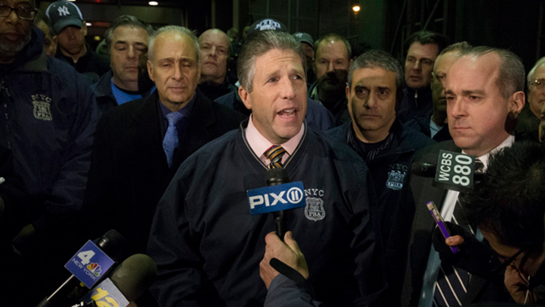 Dec. 20,2014: Patrick Lynch, head of the Patrolmen's Benevolent Association, speaks during a news conference after the bodies of two fallen NYPD police officers were transported from Woodhull Medical Center in New York. (AP Photo/John Minchillo)