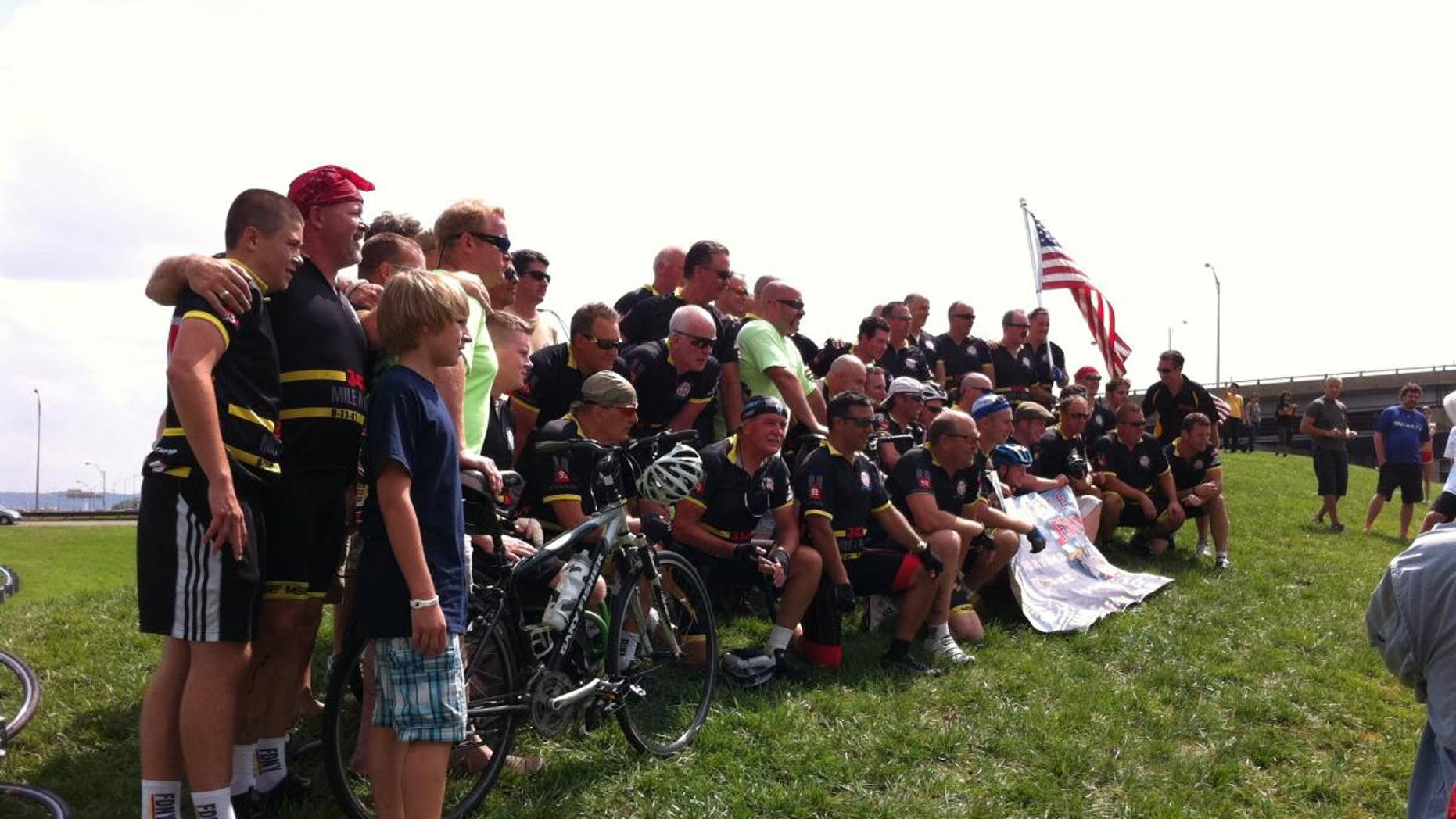 New York firefighters who biked to the Pentagon for Sunday's 9/11 anniversary pose for a picture. (Fox News Photo/Justin Fishel)