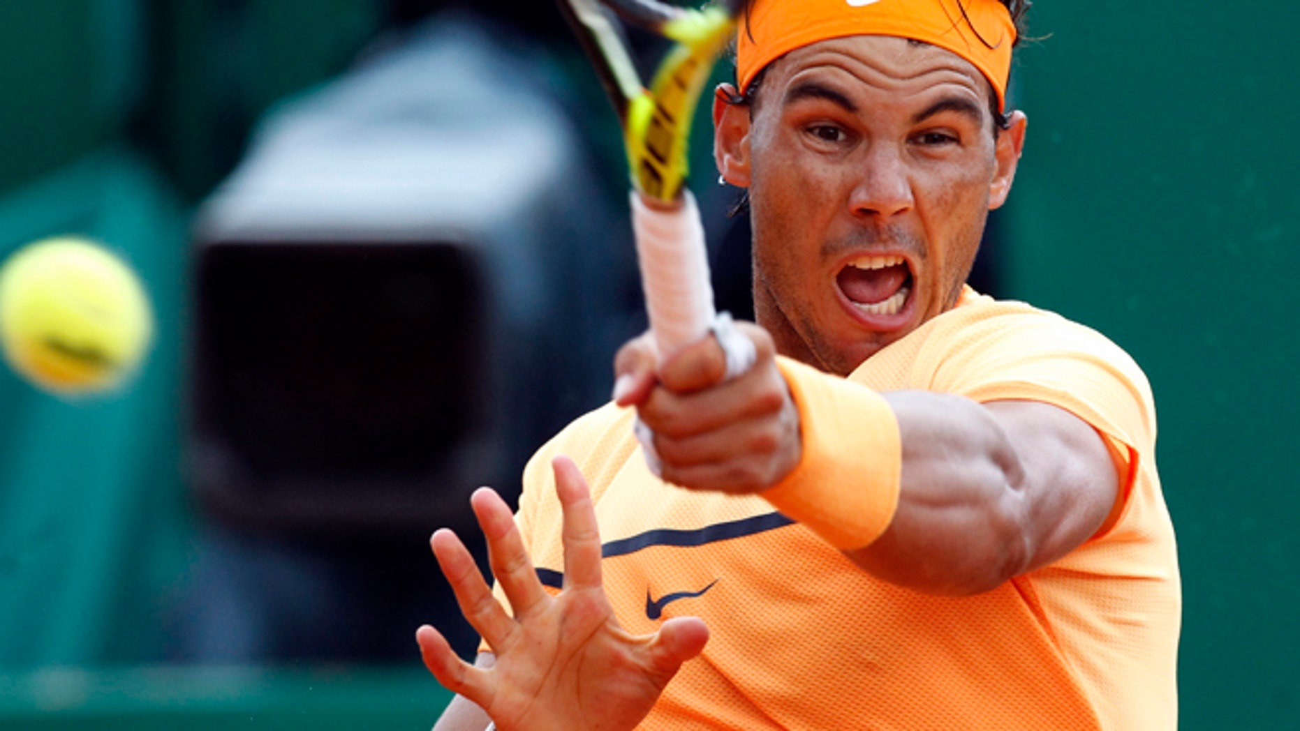 Nadal plays a return to France's Gael Monfils in Monaco, Sunday, April 17, 2016.