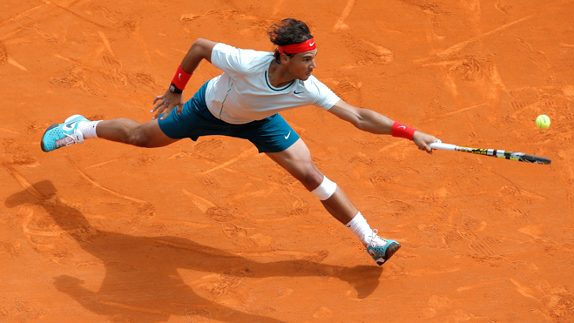 FILE - In this April 20, 2013 file photo, Spain's Rafael Nadal plays a return to France's Jo-Wilfried Tsonga during their semifinal match of the Monte Carlo Tennis Masters tournament in Monaco.  Nadal already owns a record seven titles at Roland Garros. The French Open begins Sunday, May 26, 2013. (AP Photo/Lionel Cironneau, File)