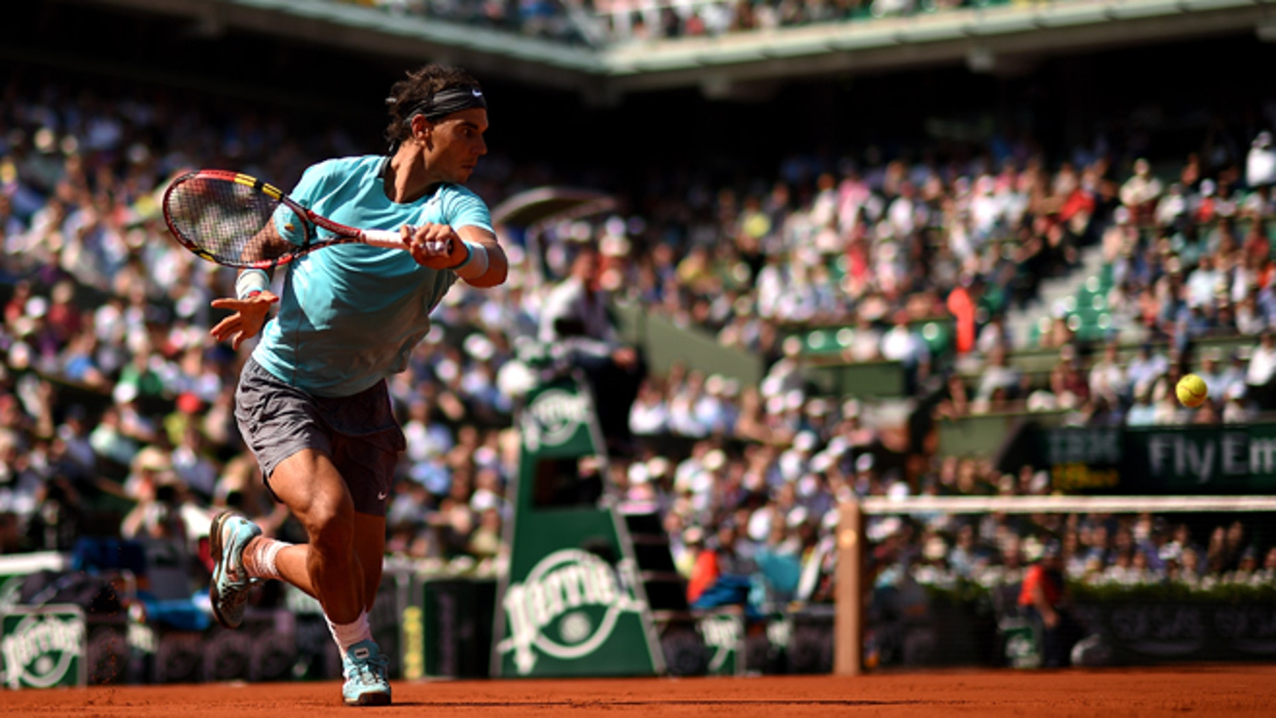 PARIS, FRANCE - MAY 31:  Rafael Nadal of Spain returns a shot during his men's singles match against Leonardo Mayer of Argentina on day seven of the French Open at Roland Garros on May 31, 2014 in Paris, France.  (Photo by Matthias Hangst/Getty Images)