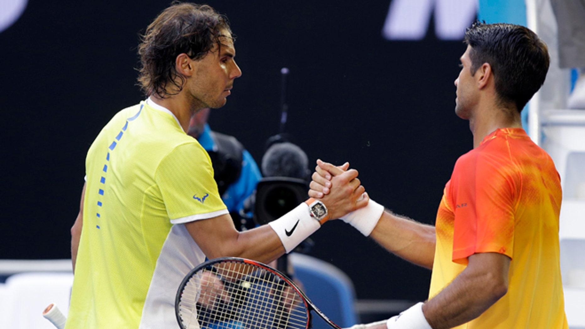Rafael Nadal, left, of Spain congratulates compatriot Fernando Verdasco after their first round match at the Australian Open tennis championships in Melbourne, Australia, Tuesday, Jan. 19, 2016.(AP Photo/Aaron Favila)