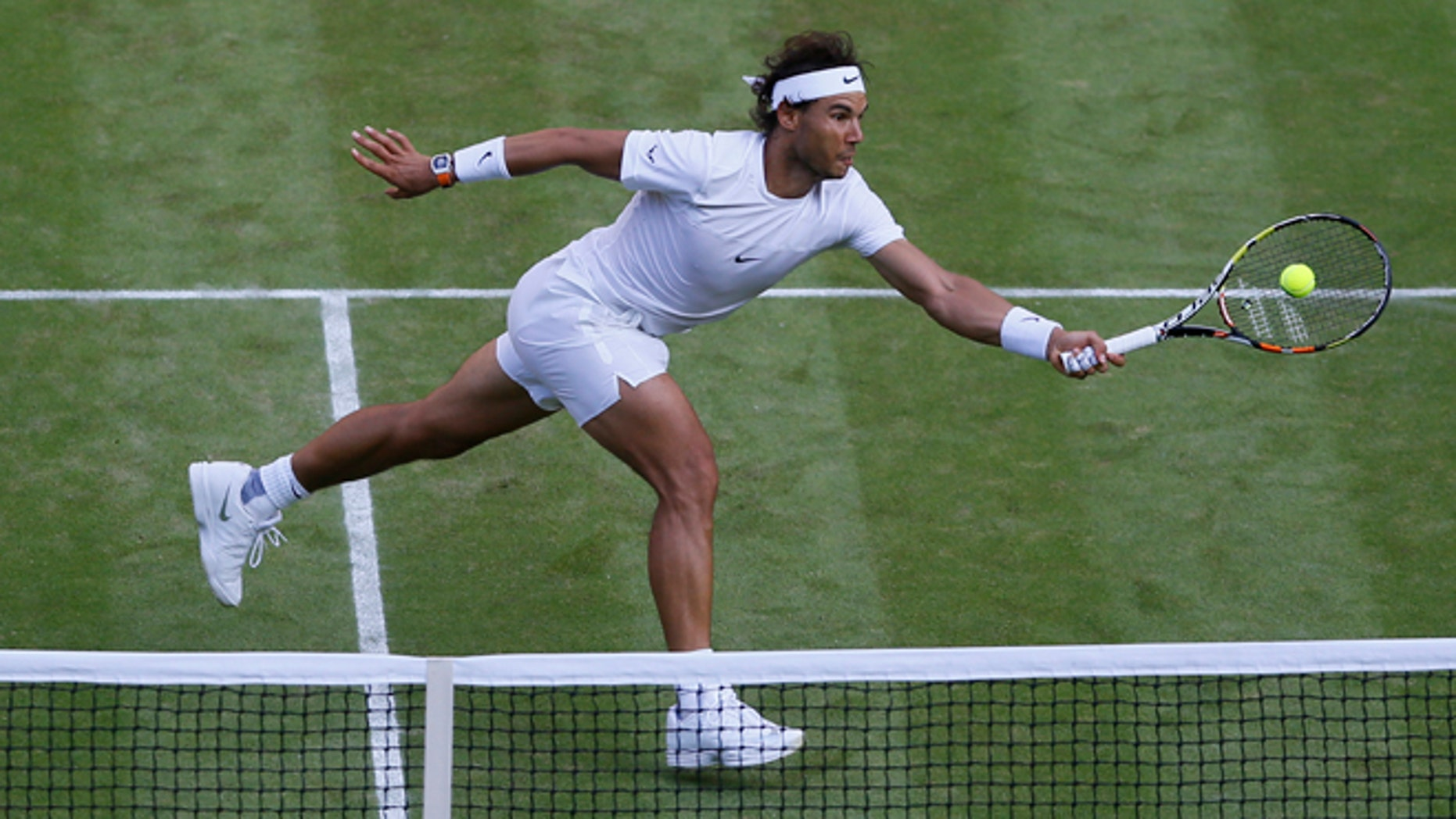 Rafael Nadal of Spain returns a ball to Dustin Brown of Germany, during their singles match at the All England Lawn Tennis Championships in Wimbledon, London, Thursday July 2, 2015. (AP Photo/Kirsty Wigglesworth)