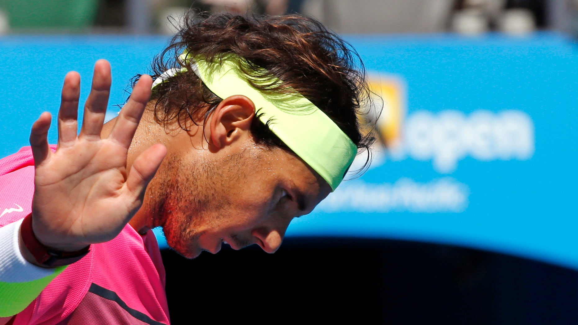 Rafael Nadal of Spain gestures as he plays Kevin Anderson of South Africa during their fourth round match at the Australian Open tennis championship in Melbourne, Australia, Sunday, Jan. 25, 2015. (AP Photo/Vincent Thian)
