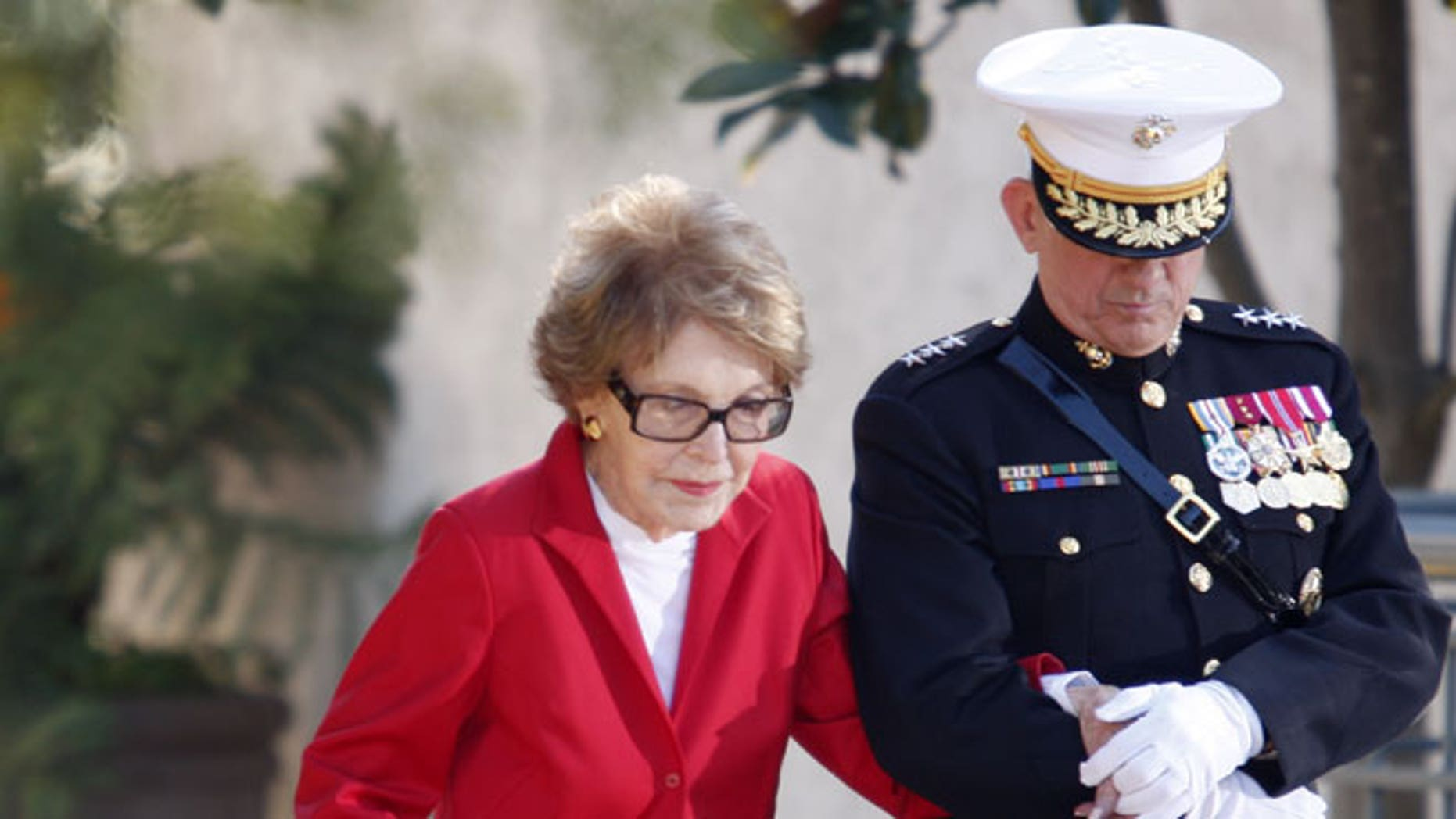 February 6, 2011: Former first lady Nancy Reagan is helped by Marine Lt. Gen. George J. Flynn as she arrives for a wreath laying ceremony at the memorial of her husband former U.S. President Ronald Reagan during the centennial birthday celebration at the Reagan Library, in Simi Valley, Calif.