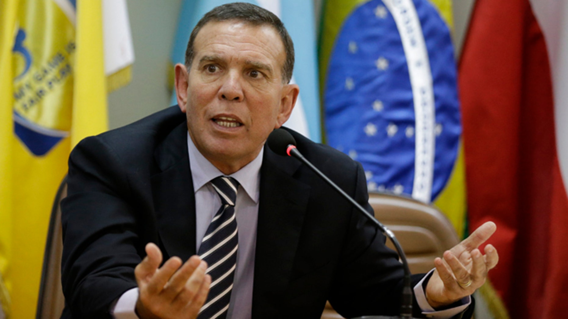 FILE - In this May 21, 2015 file photo, CONMEBOL President Juan Angel Napout talks during a press conference in Asuncion, Paraguay. Napout was arrested on Thursday, Dec. 3, 2015, in a pre-dawn raid at a luxury hotel in Switzerland as part of the U.S. Department of Justice's widening bribery case that has shaken world soccer's scandal-hit governing body, FIFA. The Swiss justice ministry says, Napout who is also a FIFA vice president, is opposing his extradition to the U.S. (AP Photo/Jorge Saenz, File)
