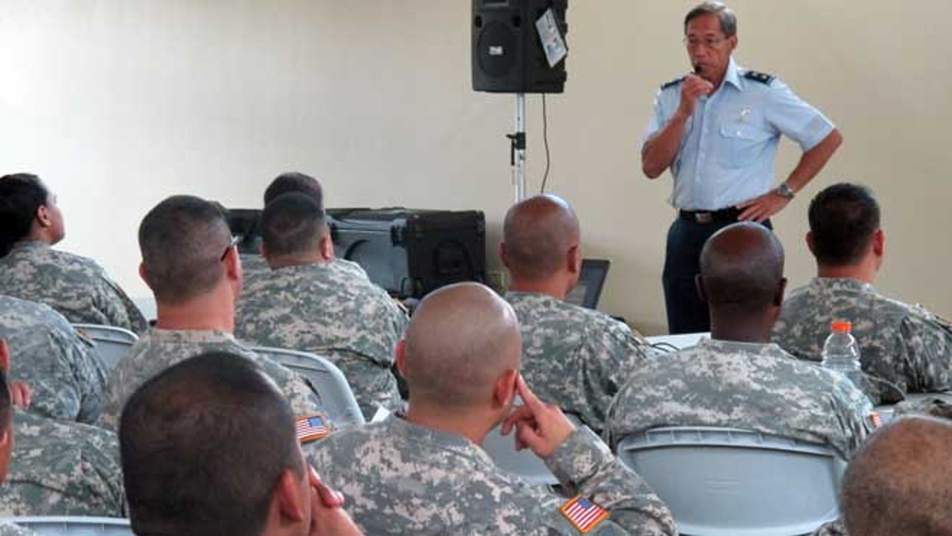 July 1, 2013: Maj. Gen. Darryll Wong, Hawaii National Guard commander, speaks to soldiers and airmen about furloughs in Kapolei, Hawaii. More than 1,100 National Guard soldiers and airmen in Hawaii and thousands in other states  will be living with 20 percent less pay over the next three months as the Defense Department carries out automatic federal budget cuts.