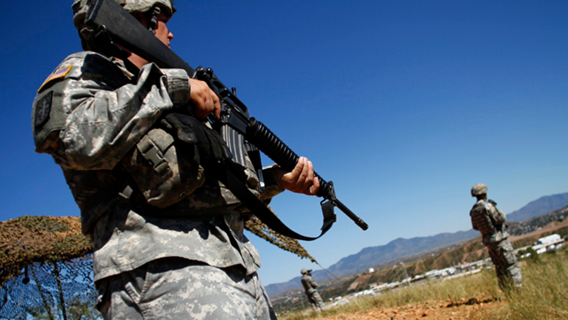 Oct. 8, 2010: National Guard troops patrol along the U.S. and Mexico border in Nogales, Ariz.