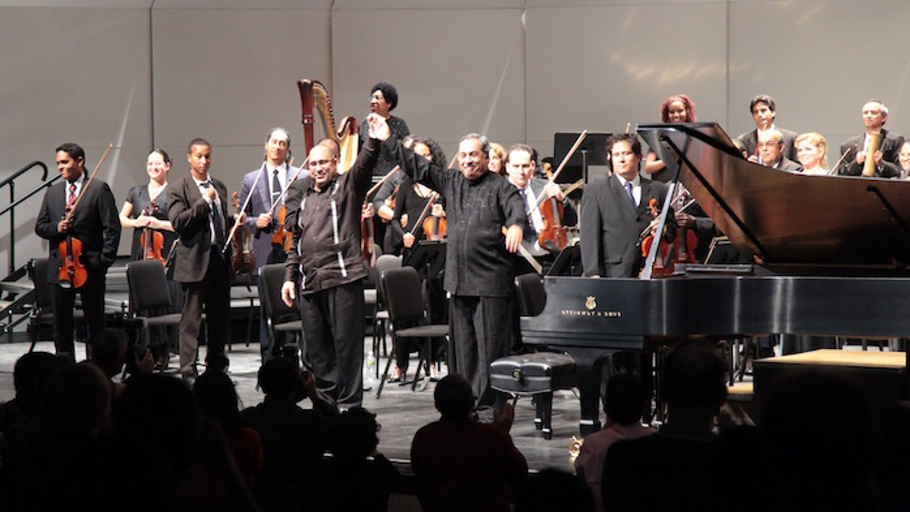 Nacho Herrera and Enrique Perez Mesa, along with the National Symphony Orchestra of Cuba, receive the applause of the audience in the Bronx