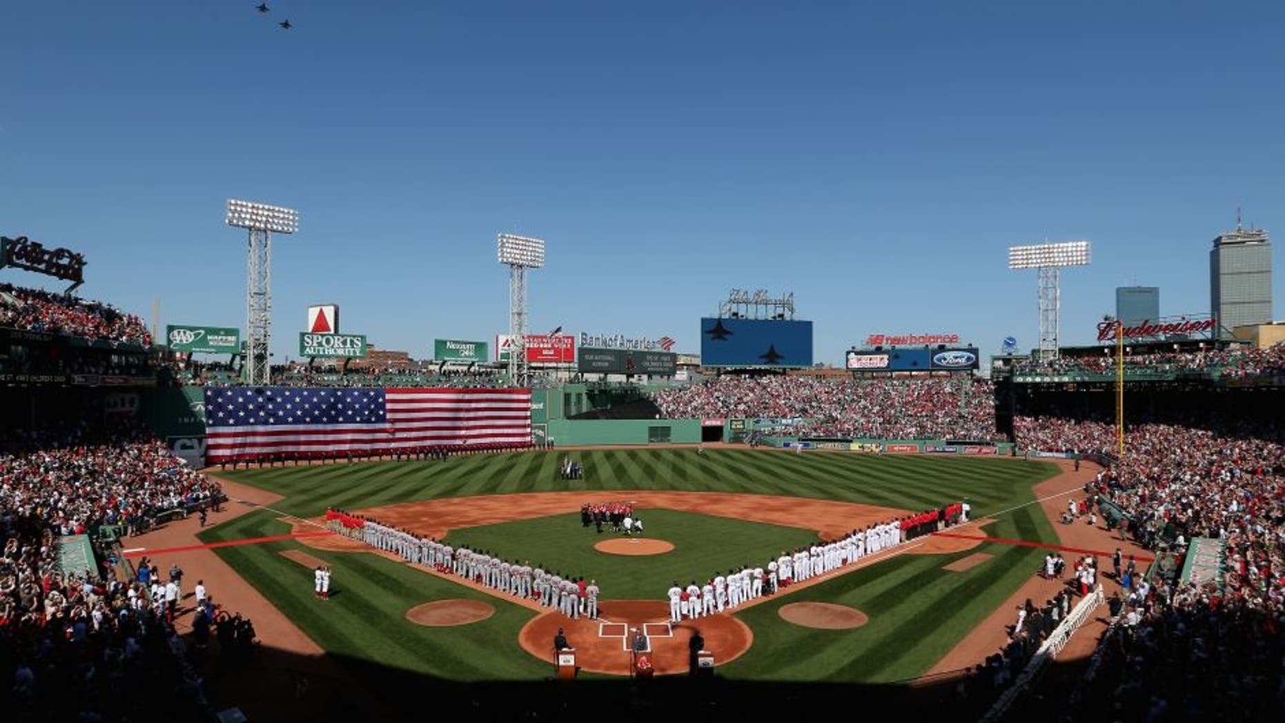 BOSTON, MA - APRIL 13: General view as the Boston Red Sox and the Washington Nationals stand on the field for the National Anthem before the game at Fenway Park on April 13, 2015 in Boston, Massachusetts. (Photo by Maddie Meyer/Getty Images)