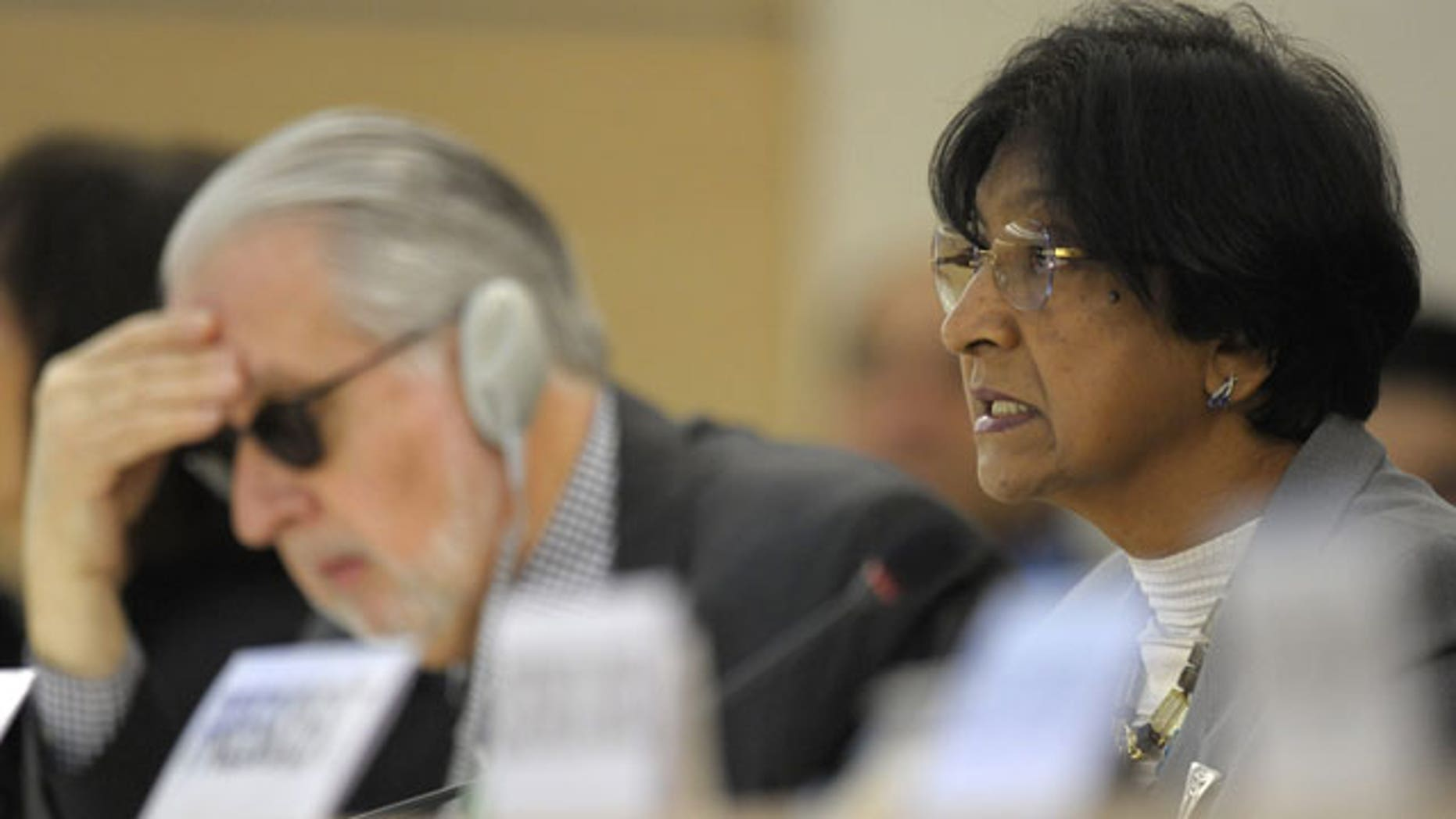 December 2, 2011: UN High Commissioner for Human Rights, South African Navanethem Pillay, right, delivers her statement next to Brazilian Paulo Pinheiro, left, Chairperson of the independent Commission of Inquiry on Syria to Human Rights Council, during the Human Rights Council Special Session on the human rights situation in the Syrian Arab Republic.