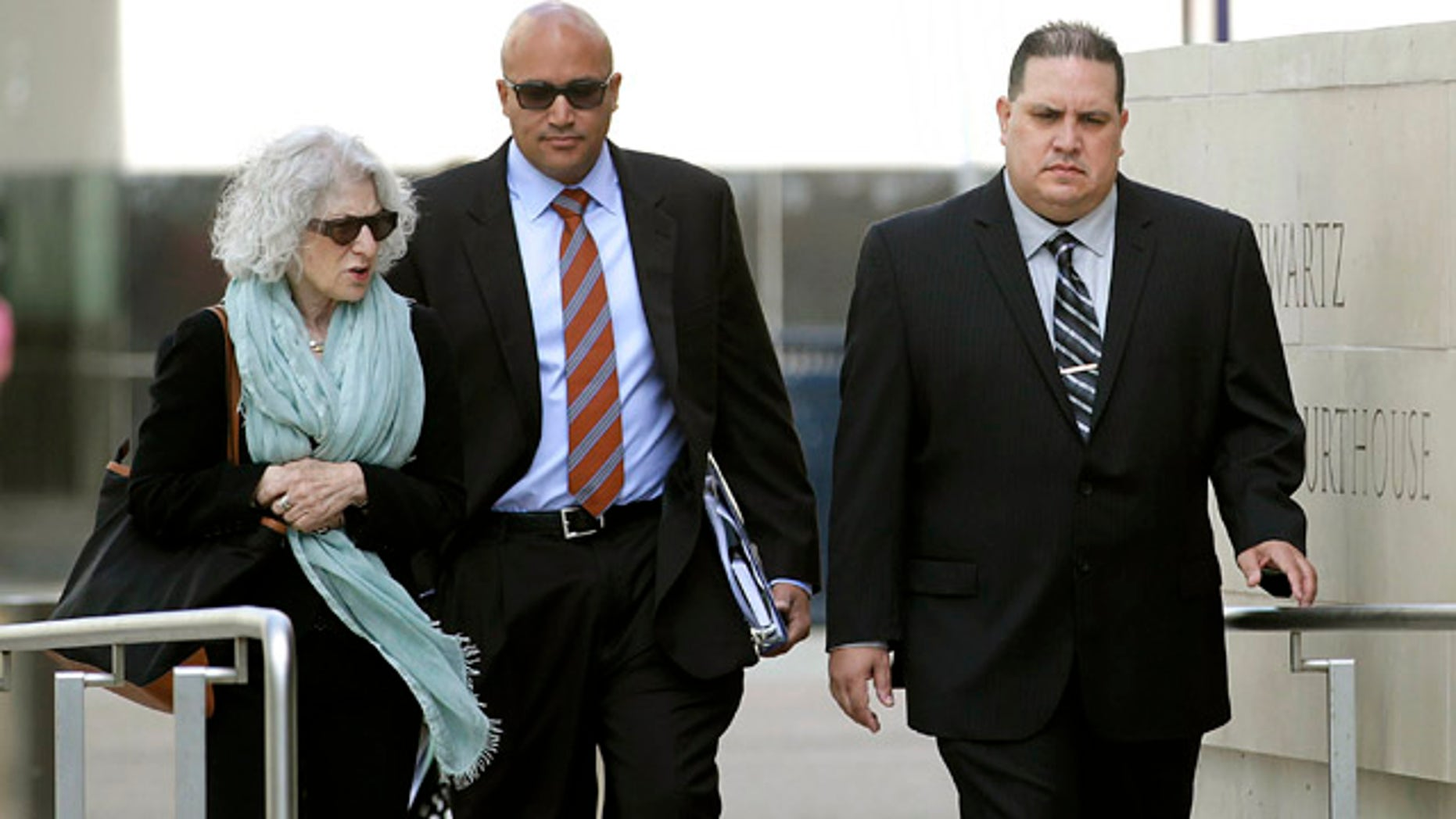 Nov. 20, 2013: Navy Cmdr. Jose Luis Sanchez, right, walks with unidentified individuals in San Diego. Sanchez pleaded guilty Tuesday in a massive bribery scheme involving a longtime military contractor in Asia who allegedly offered luxury travel, prostitutes and other bribes to Navy officers in exchange for confidential information. (AP Photo/U-T San Diego, John Gastaldo )