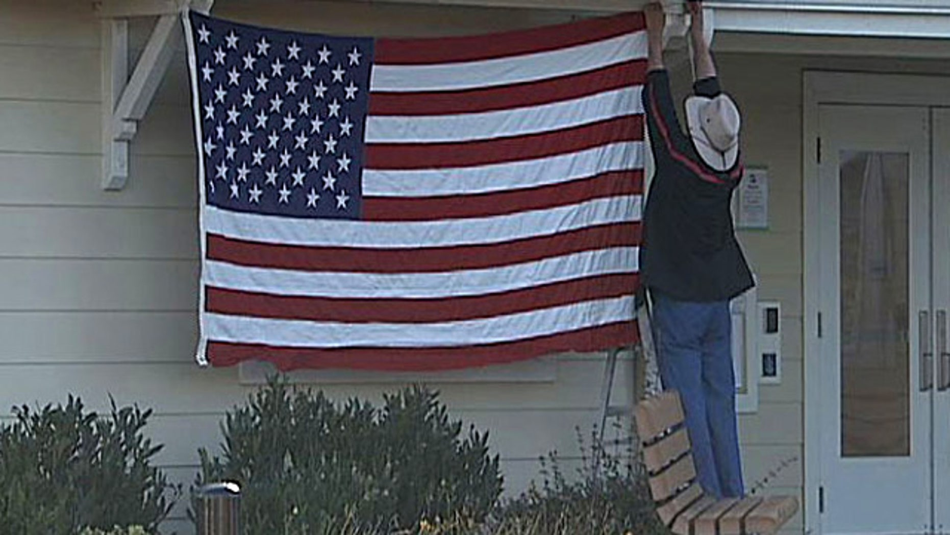 Edward Zivica faces an eviction after hanging an American flag on Navy Day.