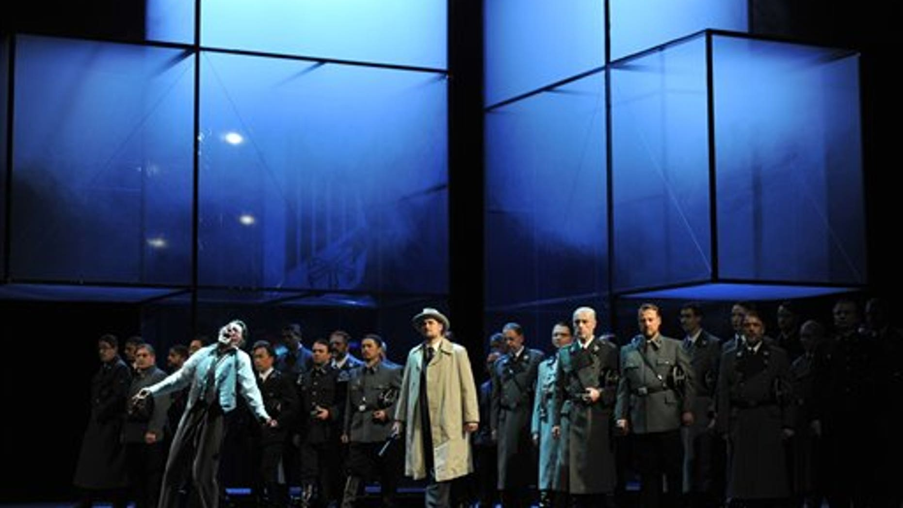 """The photo provided by Deutsche Oper am Rhein in Duesseldorf, western Germany, shows Markus Eiche, left, as Wolfram and Thorsten Gruembel as Landgraf performing in front of the choir in a scene of the the opera """"Tannhaeuser"""" during the dress rehearsal on April 30, 2013."""