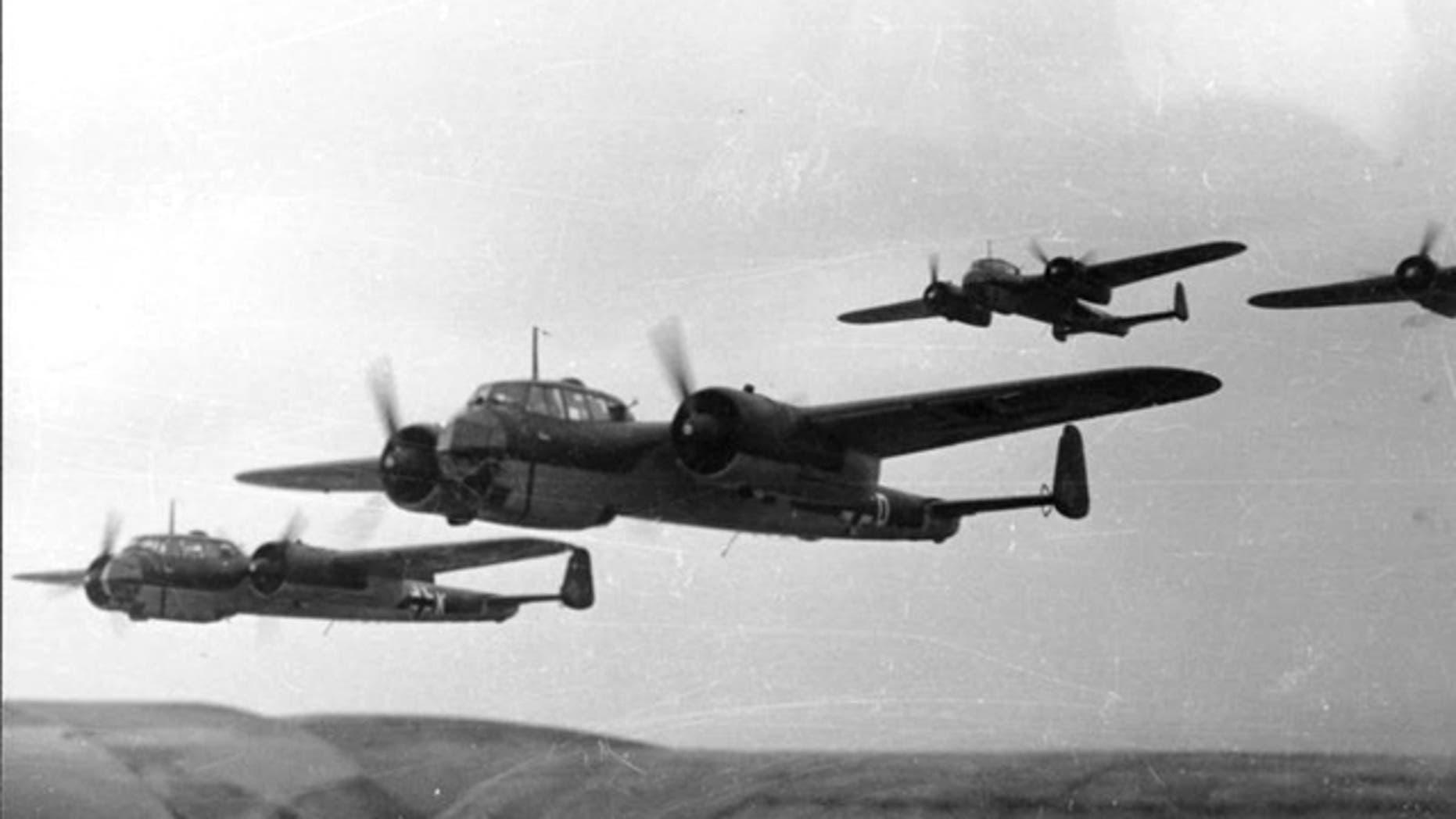 A formation of Dornier Do 17 planes flies in 1940.
