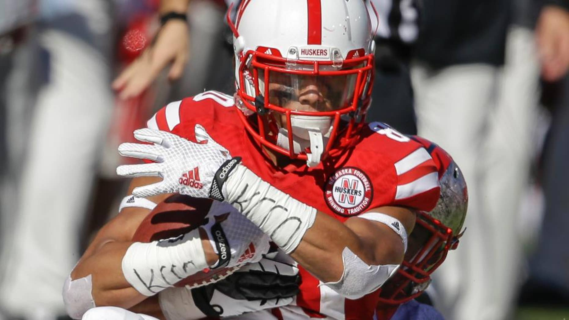 Nebraska wide receiver Kenny Bell, front, is tackled by Rutgers defensive back Andre Hunt after Bell made a catch, in the second half of an NCAA college football game in Lincoln, Neb., Saturday, Oct. 25, 2014. Bell enjoys throwing downfield blocks as much as catching passes. (AP Photo/Nati Harnik)