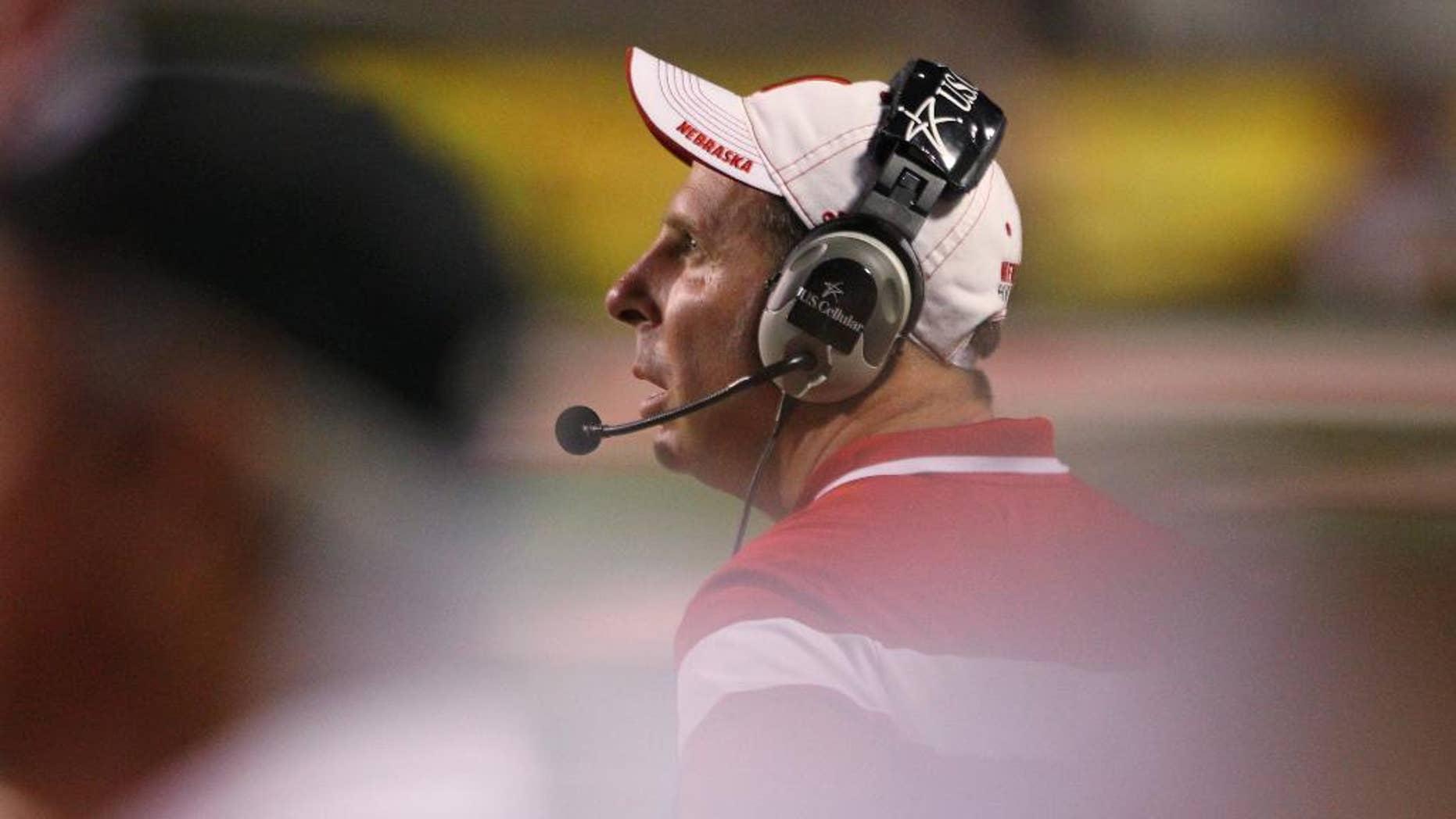 Nebraska's Bo Pelini checks the scoreboard against Fresno State in the second half of an NCAA college football game in Fresno, Calif., Saturday, Sept. 13, 2014. (AP Photo/Gary Kazanjian)