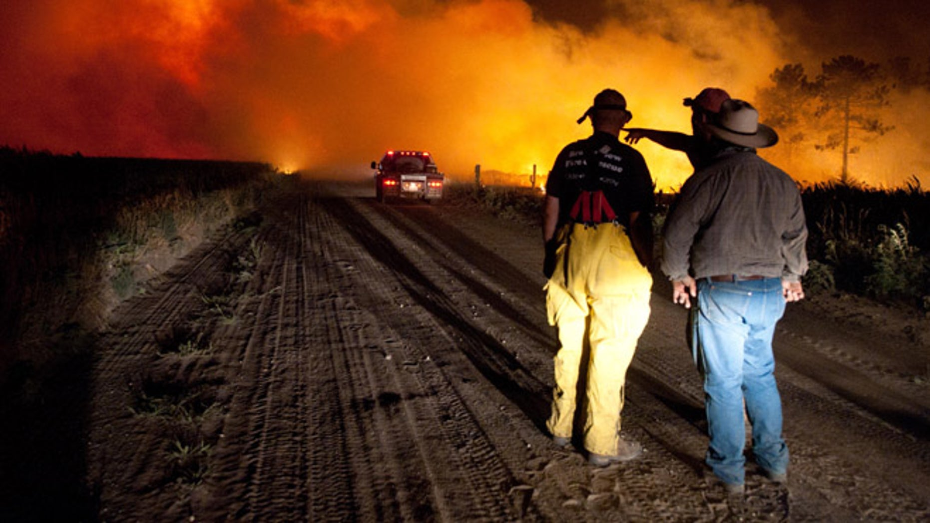 July 24: Firefighters plan an attack at the Fairfield Creek fire near Springview, Neb.