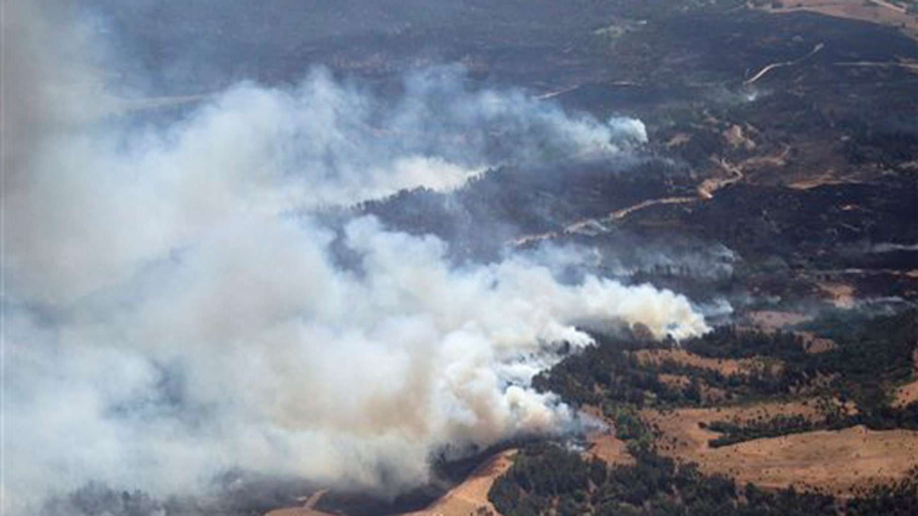 July 24, 2012: Plumes of smoke rise from the Fairfield Creek fire near Springview, Neb.