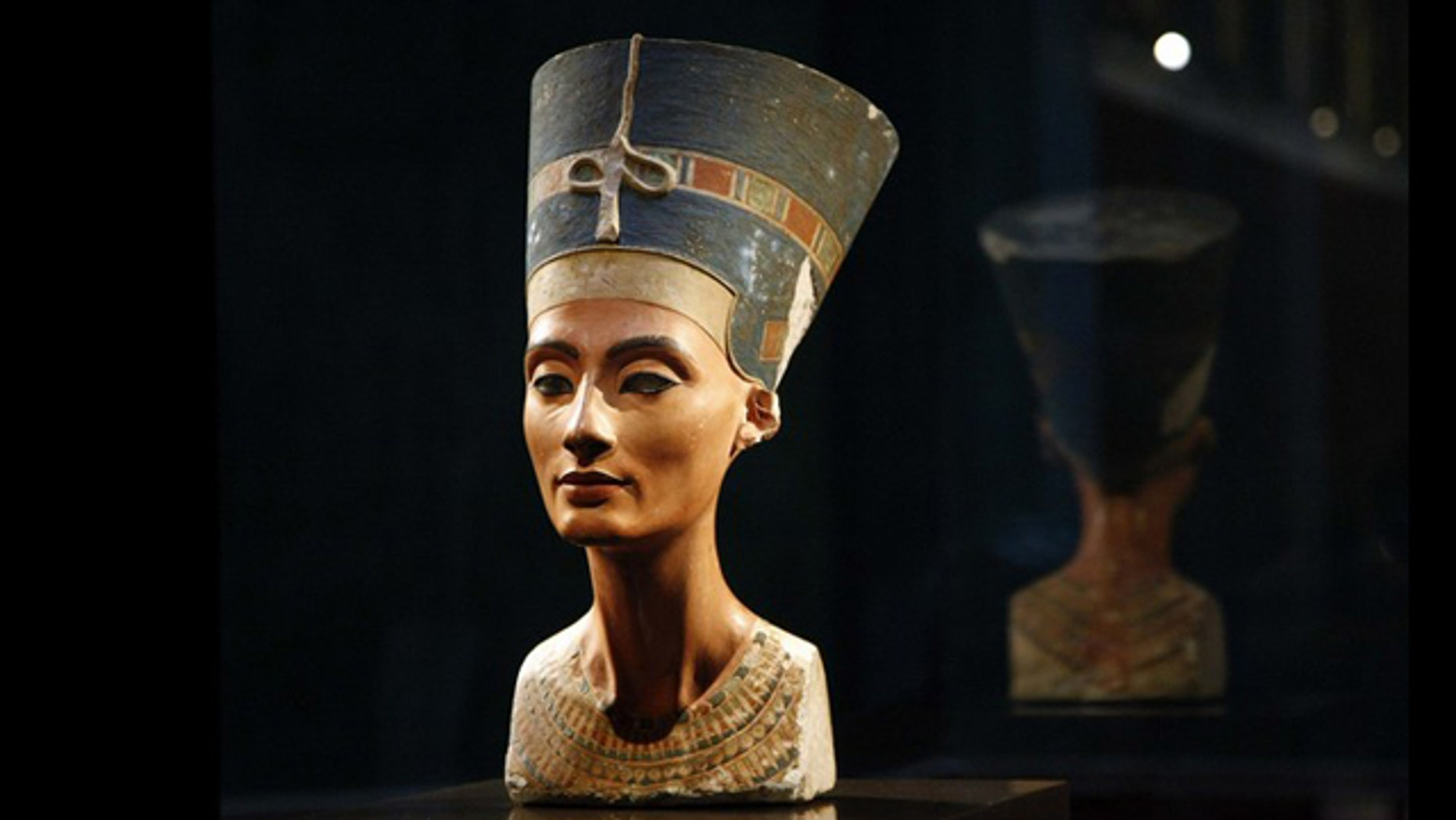 The statue of Queen Nefertiti seen during a press preview at the 'Neues Museum' (New Museum) building in Berlin October 15, 2009. As of January 24, 2011, Egypt has formally requested the return of the famous 3,400-year-old bust, which is part of a permanent Egyptian exhibition on display at the museum in Berlin.