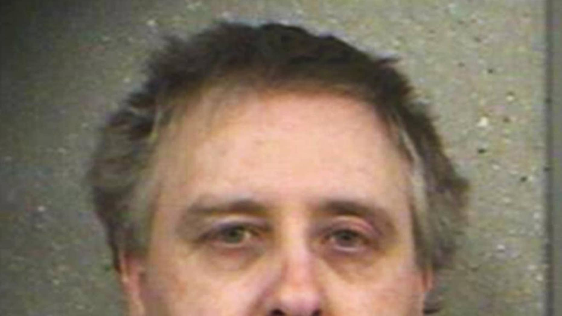 Steve Thomas is seen in this 2007 photo provided by the North Dakota Department of Corrections and Rehabilitation. Thomas who killed his neighbor in 1999 in a dispute over water drainage,  leaves prison without ever telling authorities where he dumped the body. Thomas was released Saturday, May 24, 2014. His plea agreement called for him to face a charge of murder if he was uncooperative in finding the body, but authorities say even hypnosis can't help Thomas remember where he dumped the body. (AP Photo/The North Dakota Department of Corrections and Rehabilitation)