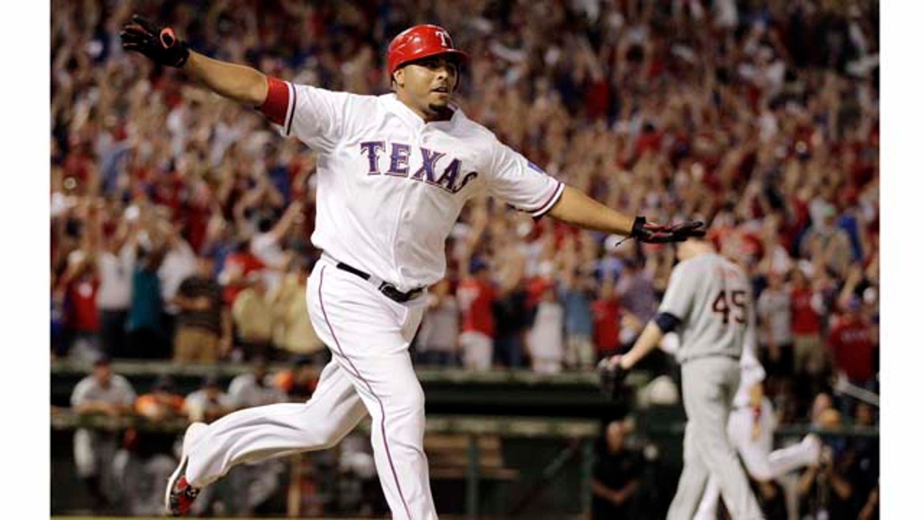Texas Rangers' Nelson Cruz reacts after hitting a grand slam home run off of Detroit Tigers Ryan Perry, rear to win Game 2 of baseball's American League championship series 7-3,  Monday, Oct. 10, 2011, in Arlington, Texas. (AP Photo/Charlie Riedel)