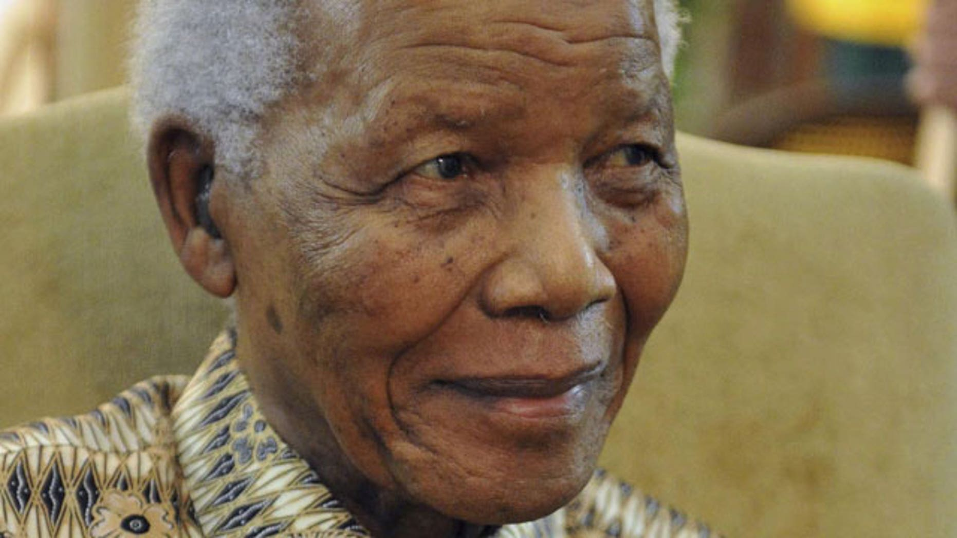 In this photo supplied by Government Communications and Information Services (GCIS) former South African President Nelson Mandela, is seen after casting his early ballot in upcoming local elections at his home in Johannesburg in this May 16, 2011 file photo.