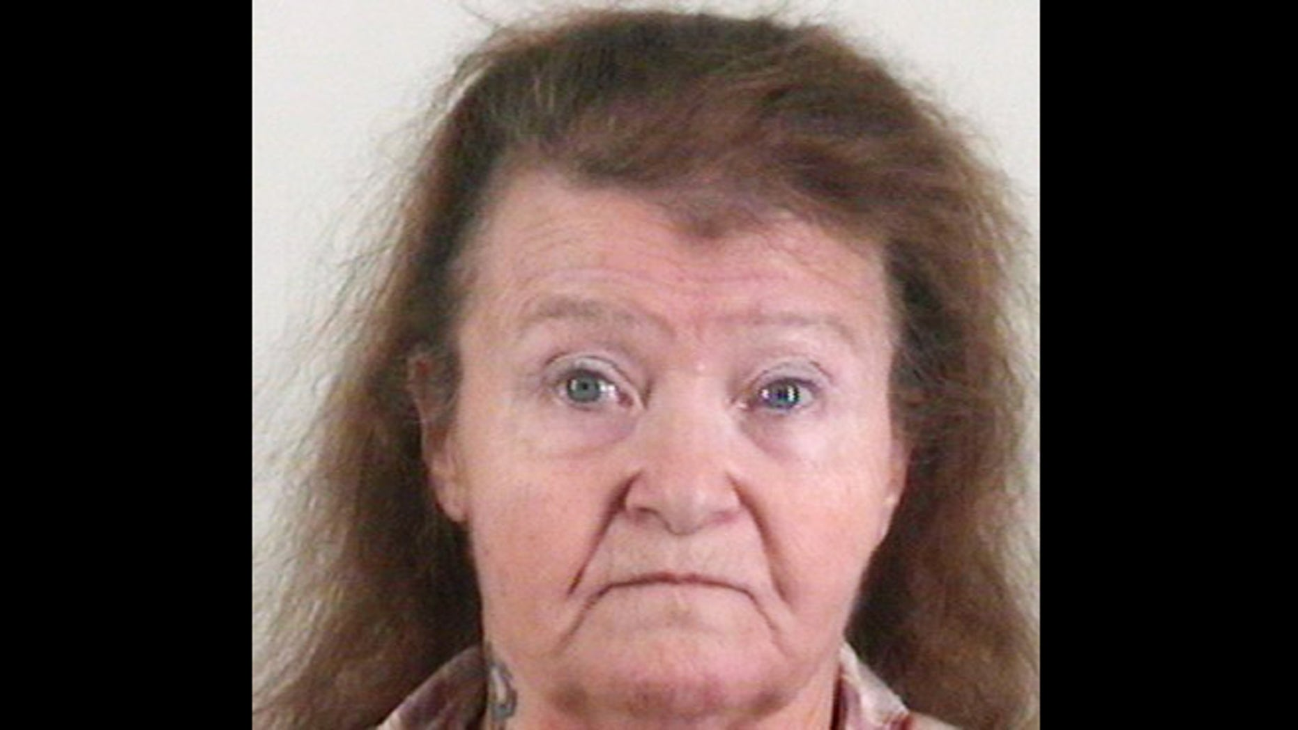 This photo provided by the Tarrant County Sheriff's Office shows Neola Robinson. The 62-year-old widow has been charged with murder after her long-missing husband, Ervin Robinson was found buried in the front yard of their Pelican Bay, Texas home. He was reported missing by his employer in May 2010.
