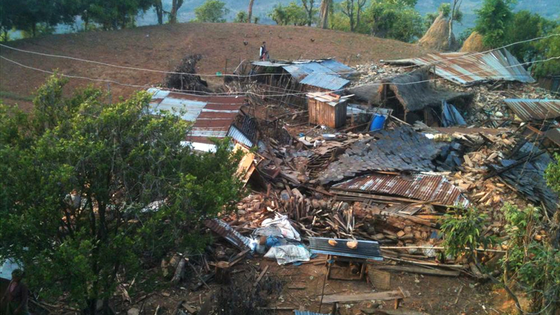 In this photo provided by World Vision, houses lie destroyed by Saturdayâs earthquake at Paslang village in Gorkha municipality, Nepal, Monday, April 27, 2015. Reports received so far by the government and aid groups suggest that many communities perched on mountainsides are devastated or struggling to cope. Udav Prashad Timalsina, the top official for the Gorkha district, near the epicenter of Saturday's quake, said he was in desperate need of help. (Bishwo Ghimire/World Vision via AP)