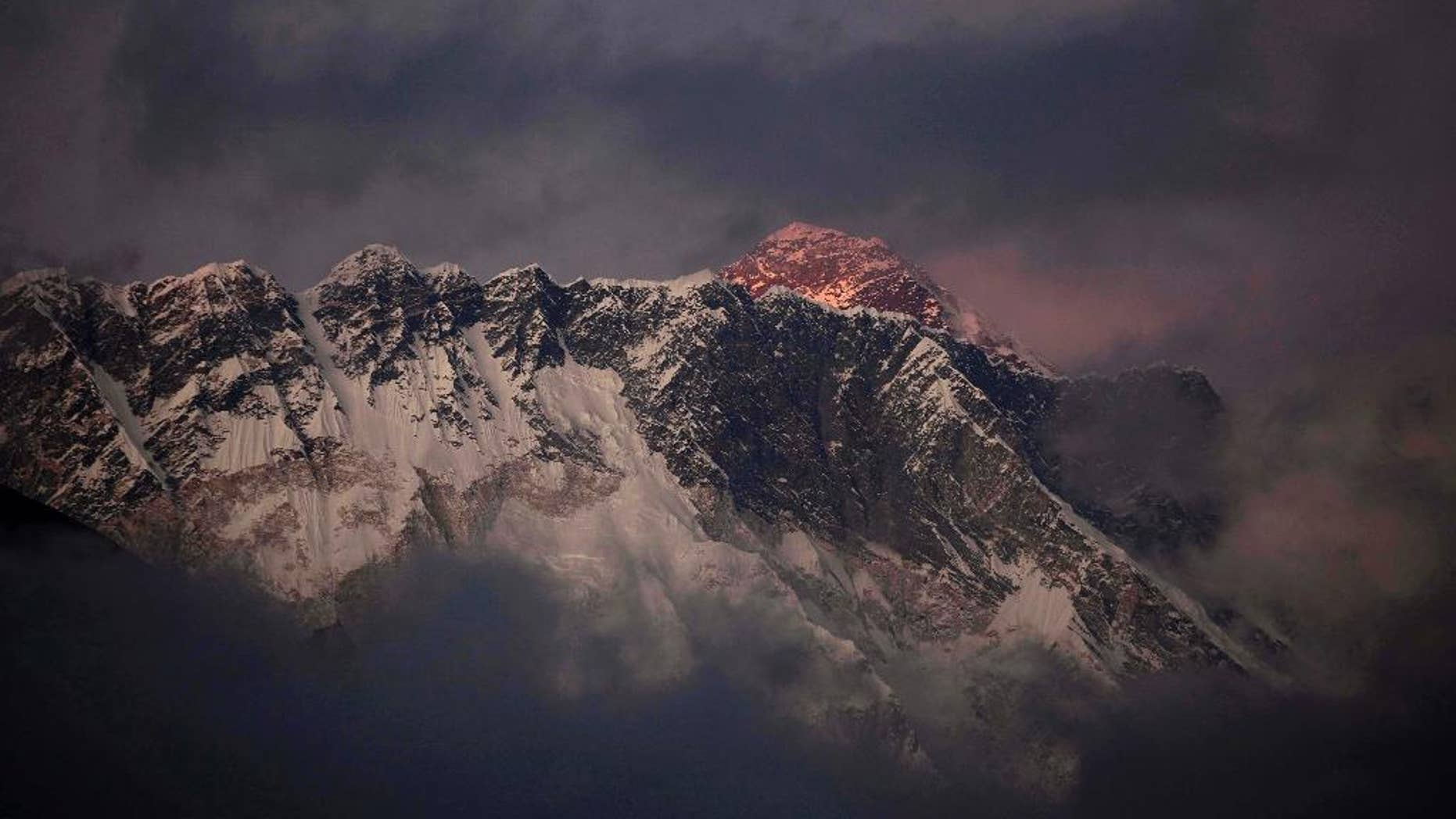 FILE - In this Oct. 27, 2011 file photo, the last light of the day sets on Mount Everest as it rises behind Mount Nuptse as seen from Tengboche, in the Himalaya's Khumbu region, Nepal. Nepal is improving weather forecasting systems, stepping up security and promises swift rescues if needed during the upcoming climbing season on Everest in attempt to recover from the worst mountaineering disaster on the world's highest peak last year, officials said Monday. (AP Photo/Kevin Frayer, File)