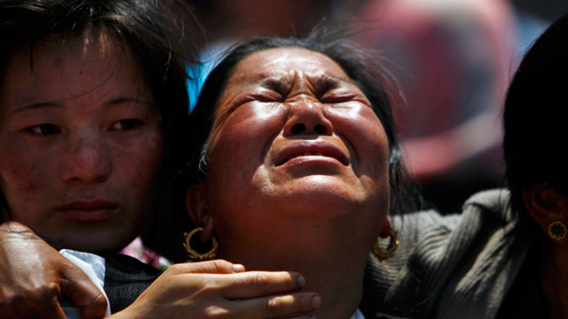 April 21, 2014: Relatives of mountaineers killed in an avalanche on Mount Everest cry during the funeral ceremony in Katmandu, Nepal.