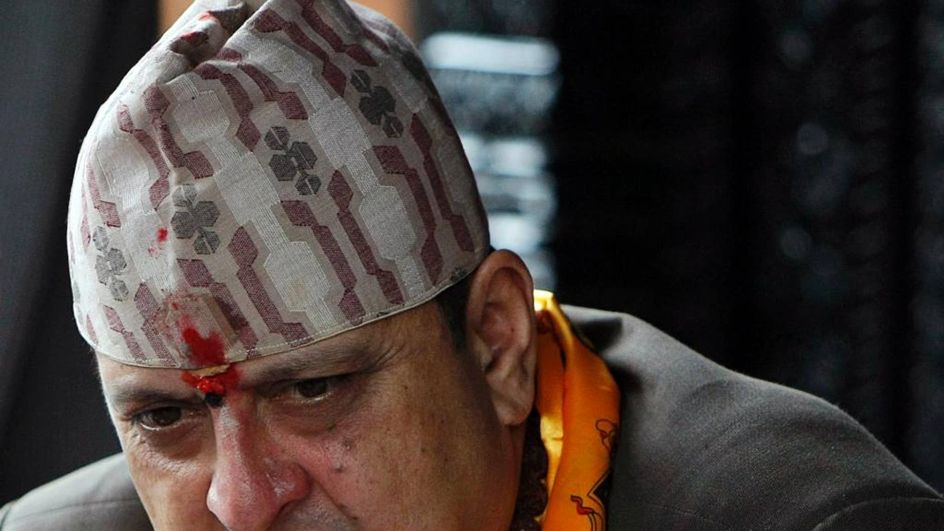 FILE - In this July 7, 2011 file photo, Nepal's former King Gyanendra listens to a supporter on his 64th birthday at his residence in Katmandu, Nepal. The last king of Nepal is in stable condition in a hospital after suffering a heart attack, doctors said Sunday, Sept. 21, 2014. (AP Photo/Binod Joshi)