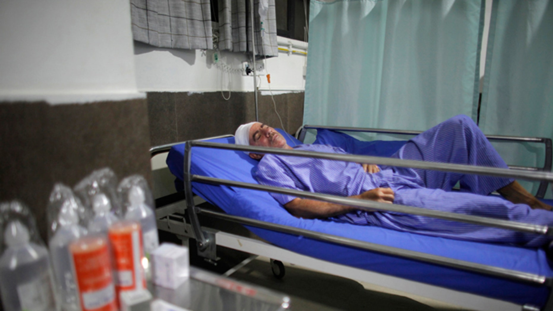 Spanish trekker Juan Mari Eguillor, 68, who survived a landslide receives treatment at Vayodha Hospital in Kathmandu, Nepal, Thursday, Sept. 22, 2016. A Spanish trekker and three Nepalese guides were killed Thursday and more than a dozen injured when they were hit by a landslide triggered by heavy rain in Nepal's northern mountains, officials said.(AP Photo/Niranjan Shrestha)