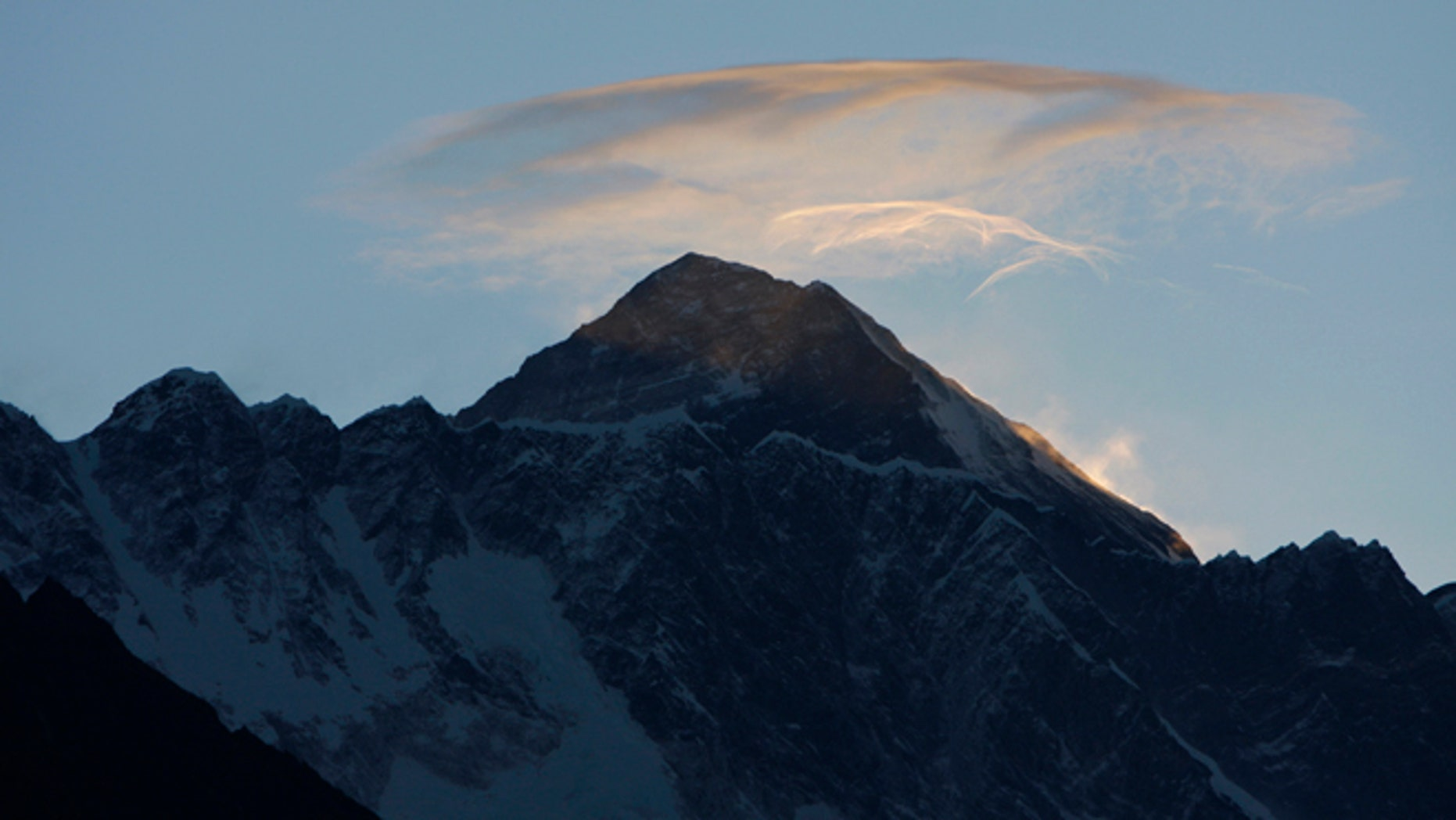 May 19, 2010: Clouds hover above the world's highest peak Mount Everest, as seen from Syangboche, about 125 kilometers (80 miles) northeast of Katmandu, Nepal.