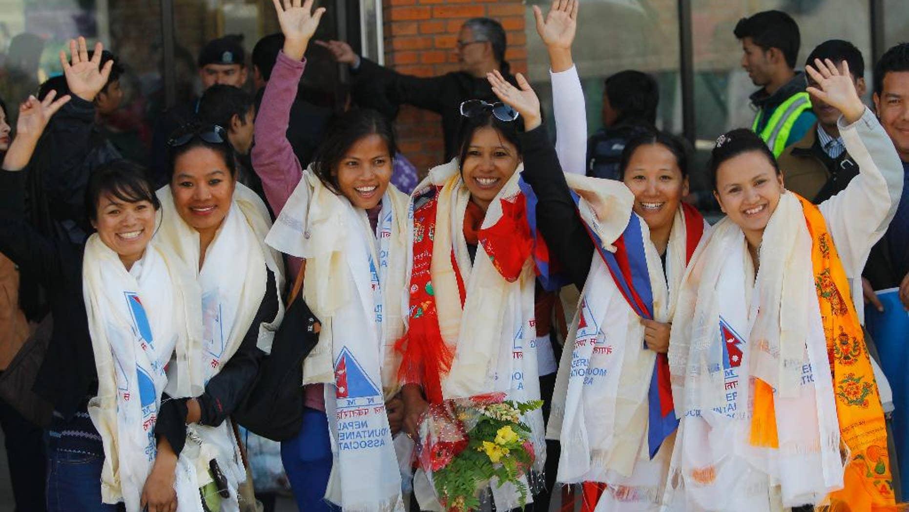 Jan. 9, 2015: From left to right: Nepalese climbers Nimdoma Sherpa, Maya Gurung, Asha Singh, Chunu Shrestha, Pema Dikki and Shailee Basnet pose for the media at the Tribhuwan International Airport, Kathmandu.