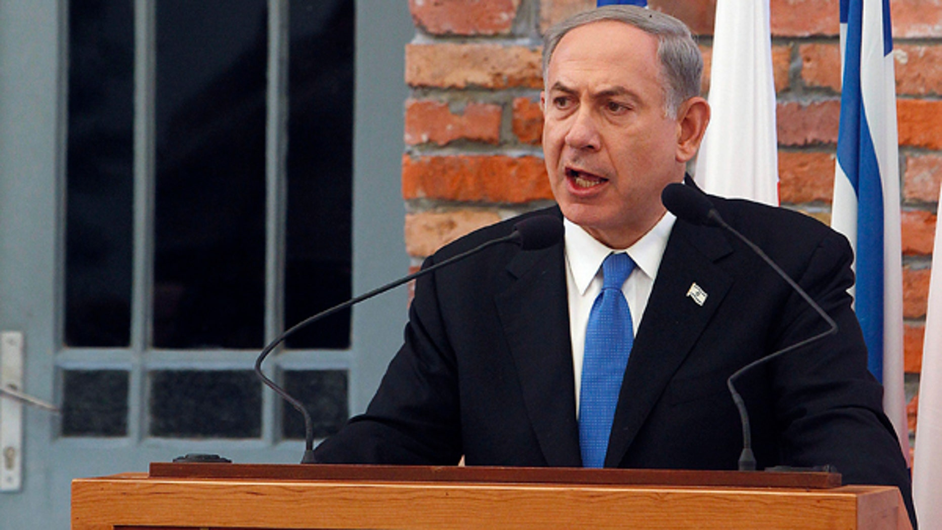 June 13, 2013: Israeli Prime Minister Benjamin Netanyahu delivers a speech following the opening of a new pavilion at the former Nazi death camp of Auschwitz, in Oswiecim, Poland. The exhibition in Bloc 27 is meant to educate visitors about the Holocaust and the Nazi Germanys quest to exterminate the Jewish people.