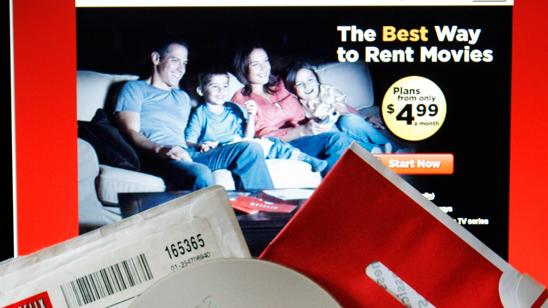 A DVD rental from Netflix is seen with the company's website.