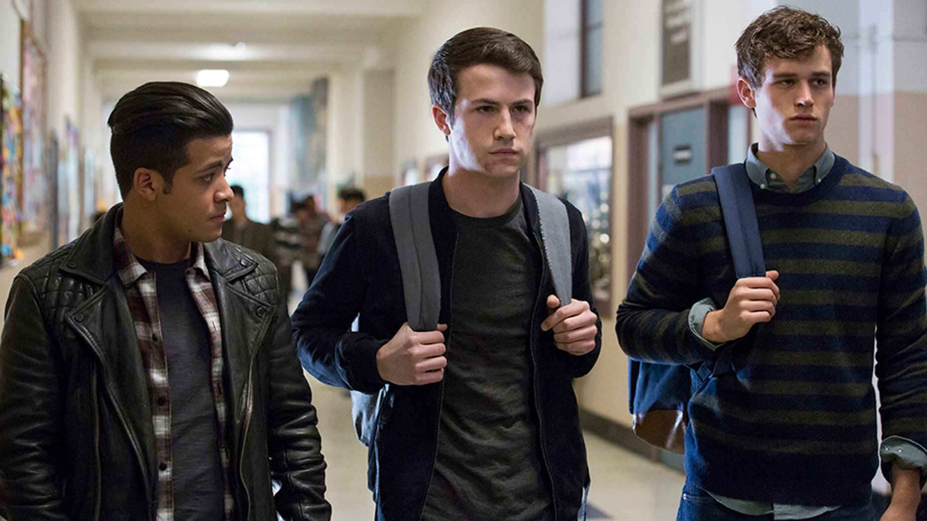 "This image released by Netflix shows, from left, Christian Navarro, Dylan Minnette and Brandon Flynn in ""13 Reasons Why."""