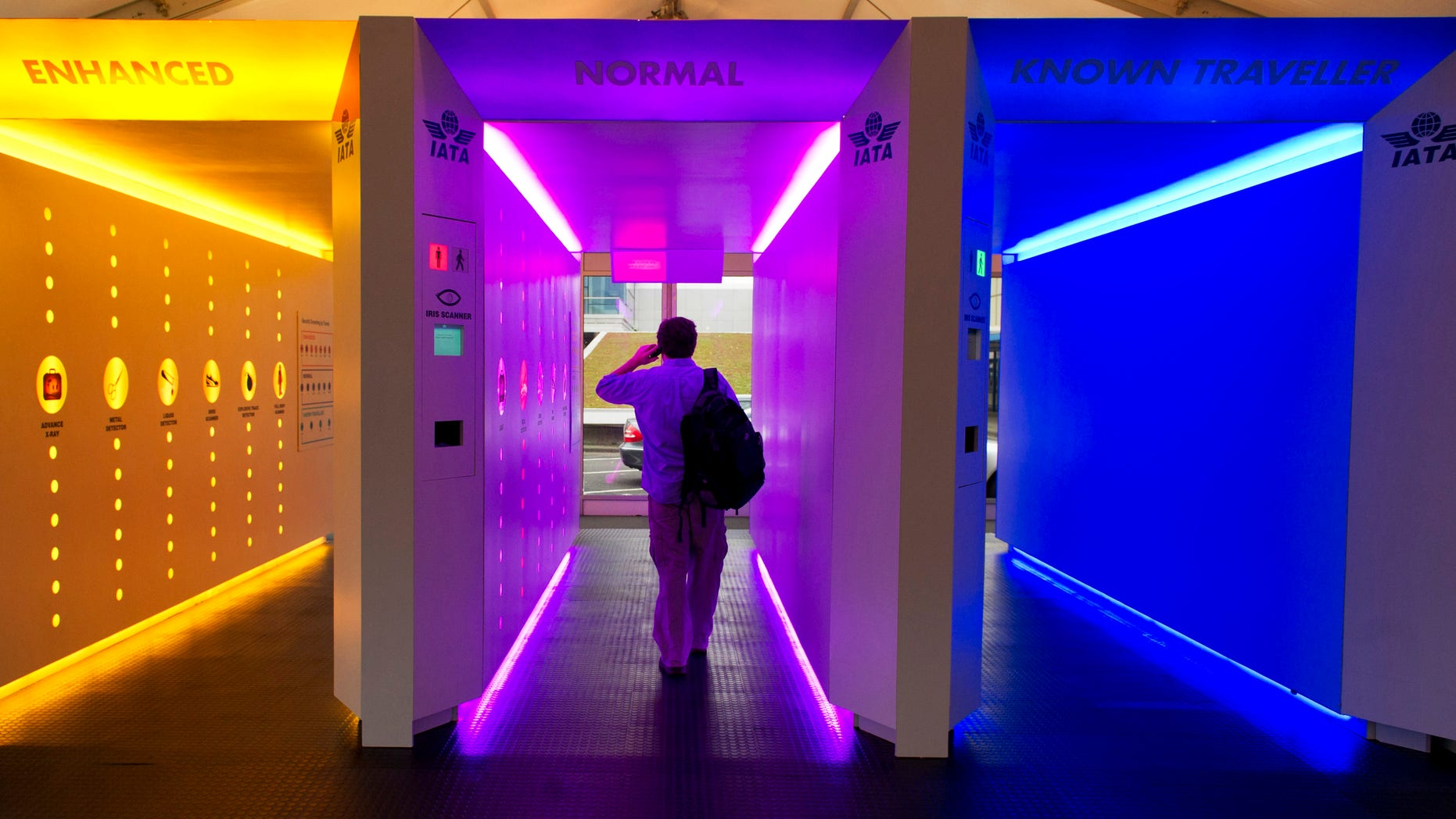 A person walks through a model of a scanning corridor at the International Air Transport Association Aviation Security (IATA AVSEC) conference in Amsterdam, Netherlands, Tuesday, Oct. 4, 2011. The airline industry has presented its vision for a security 'checkpoint of the future,' which would speed up safety checks by sorting passengers according to the level of risk they pose.