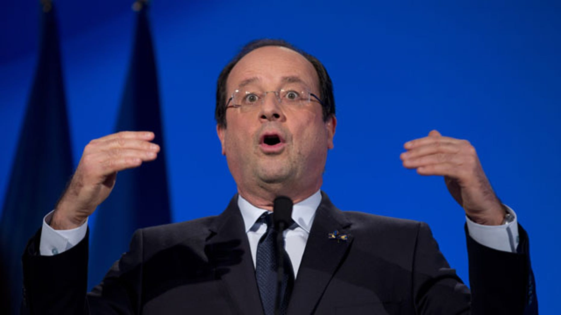January 20, 2014: French President Francois Hollande raises his hands during a speech at the National Maritime Museum in Amsterdam, Netherlands. (AP Photo/Peter Dejong)