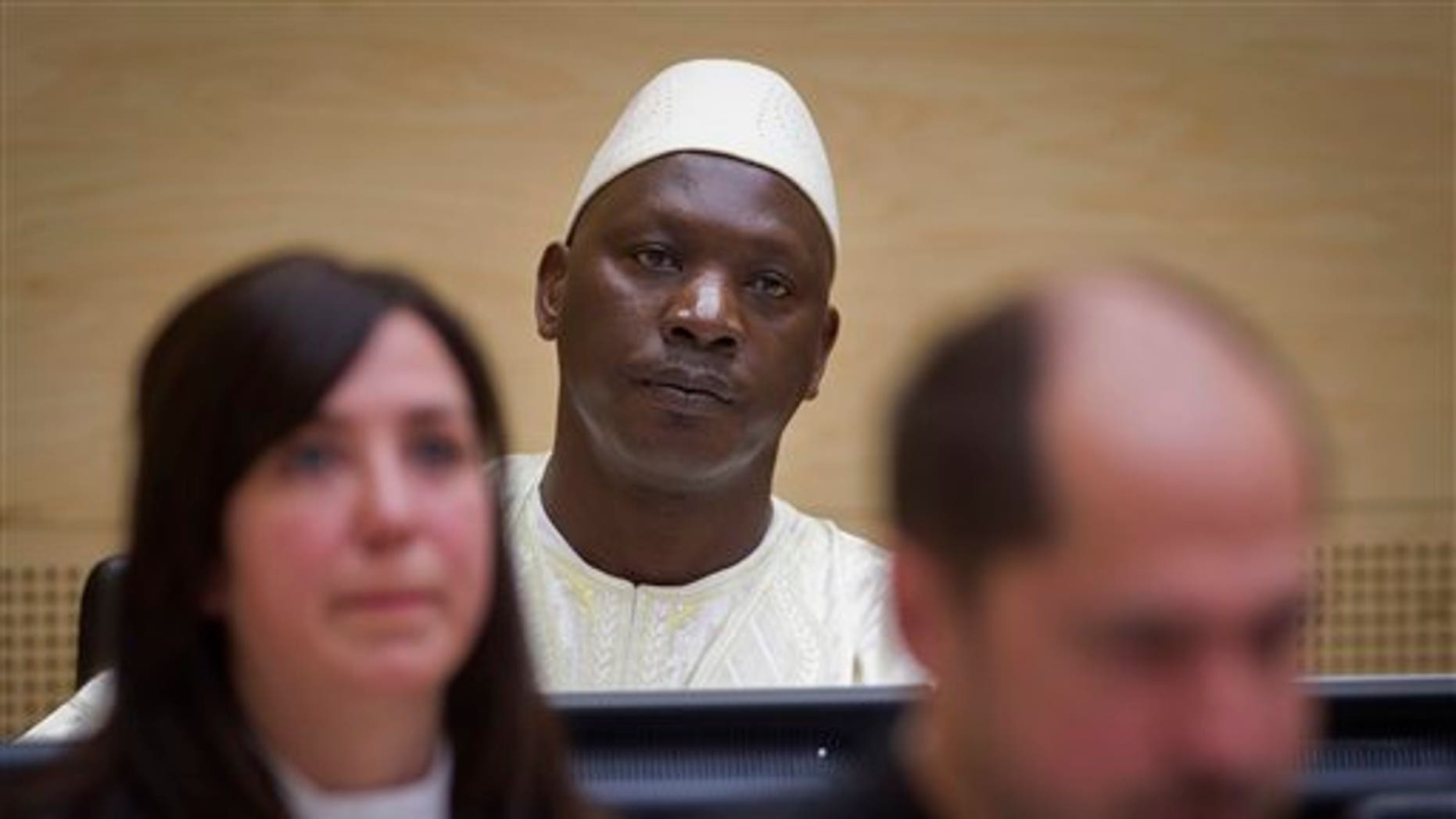 March 14, 2012: Congolese warlord Thomas Lubanga, center, awaits his verdict in the courtroom of the International Criminal Court (ICC) in The Hague, Netherlands.