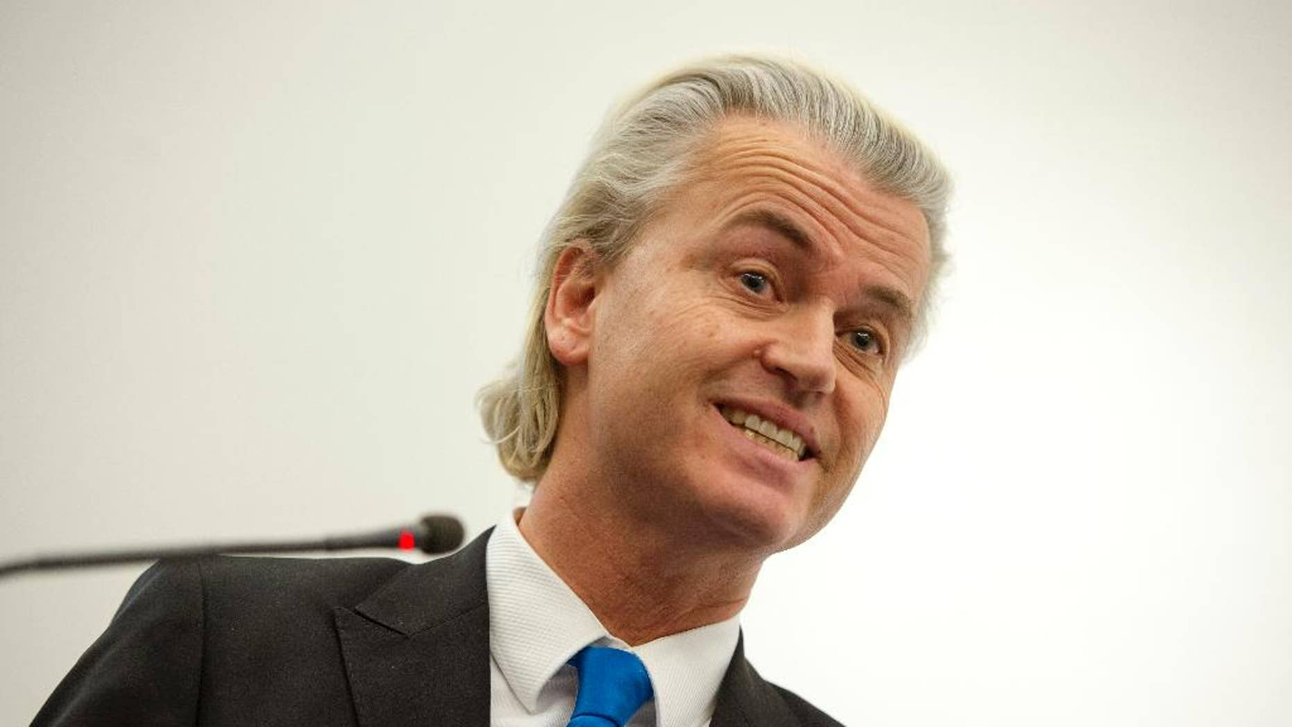 """FILE - In this Thursday, Feb. 6, 2014 file photo, Dutch populist politician Geert Wilders presents a study, during a press conference in The Hague, Netherlands. The Dutch right-wing populist politician Geert Wilders has led his supporters in an anti-Moroccan chant. At a party meeting Wednesday evening, March 19, 2014 in The Hague, where his Freedom Party is set to win the most votes in municipal elections, Wilders asked supporters whether they wanted """"more or fewer"""" Moroccans in the Netherlands. His supporters chanted back: """"Fewer! Fewer! Fewer!"""" before breaking into applause. Wilders' party is the fourth-largest in Parliament but leads in national opinion polls. His rise to popularity in the Netherlands over the past decade came amid a surge of anti-immigrant sentiment in a country once famed for its tolerance. (AP Photo/Patrick Post, File)"""